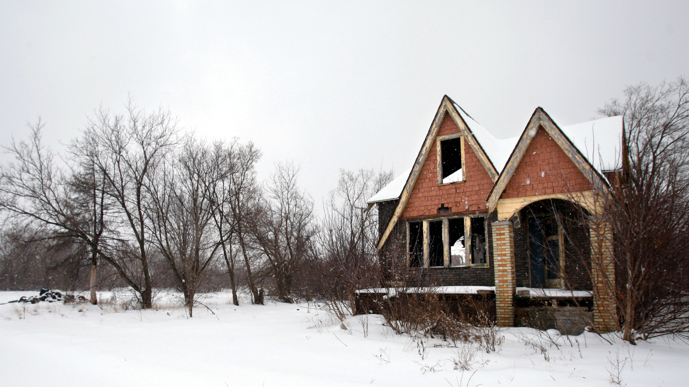 A vacant house near City Airport is seen Feb. 23, 2010 in Detroit. After decades of decline that gutted many once-vibrant neighborhoods, Detroit is preparing a radical renewal effort on a scale never attempted in this country: returning a large swath of the city to fields or farmland, much like it was in the middle of the 19th century. Under plans now being refined, demolition crews would move through the most desolate and decayed areas of urban Detroit with building-chomping excavators, reducing houses to rubble.