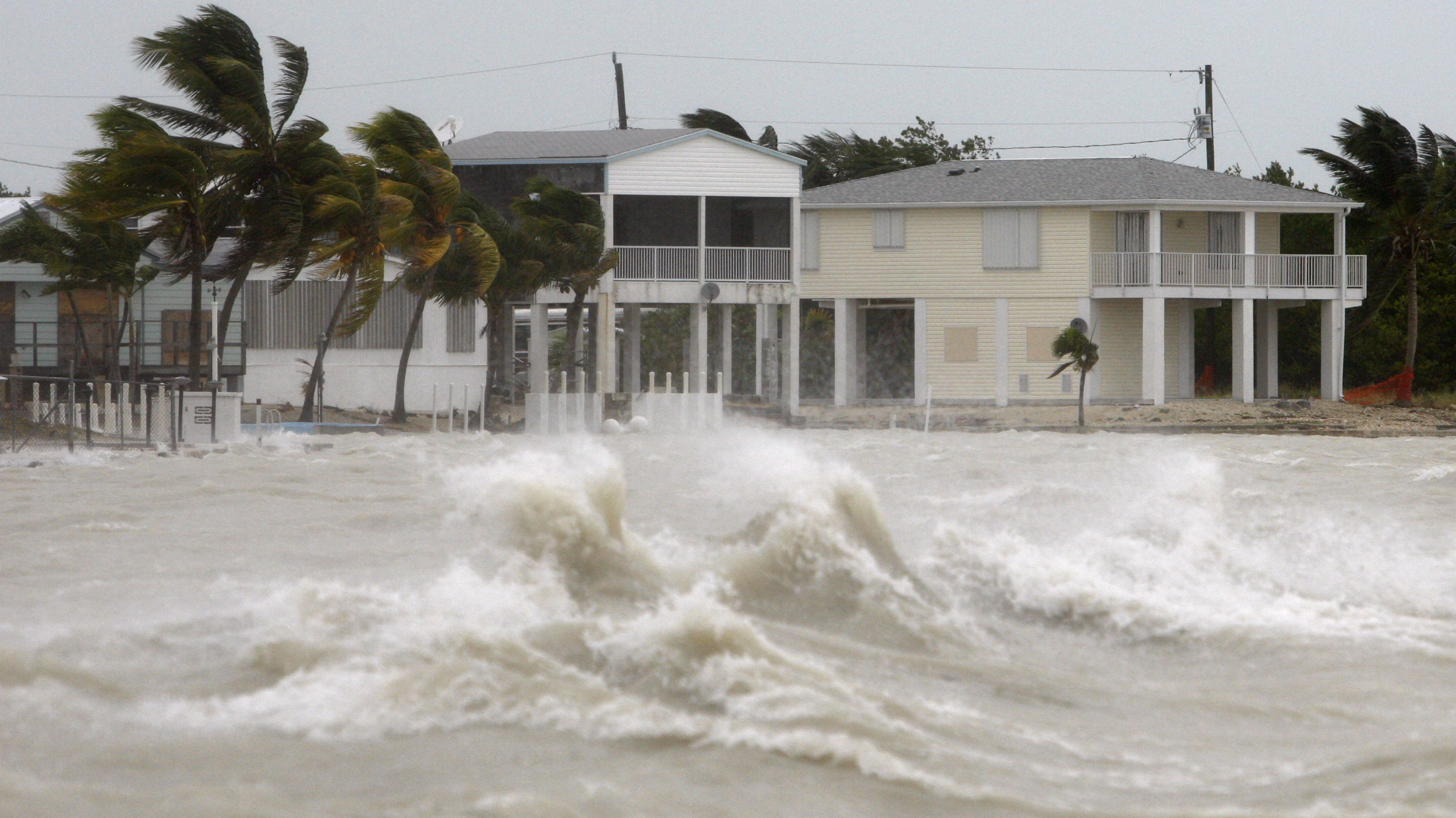 Strong waves crash around coastal houses in Key West, Florida, as Hurricane Ike passes to the south September 9, 2008. Hurricane Ike remained a Category 1 storm with winds near 80 miles per hour as it approached western Cuba before charging toward the oil-rich South Texas coast later in the week, the U.S. National Hurricane Center said in its 8 a.m. EDT report Tuesday. REUTERS/Carlos Barria