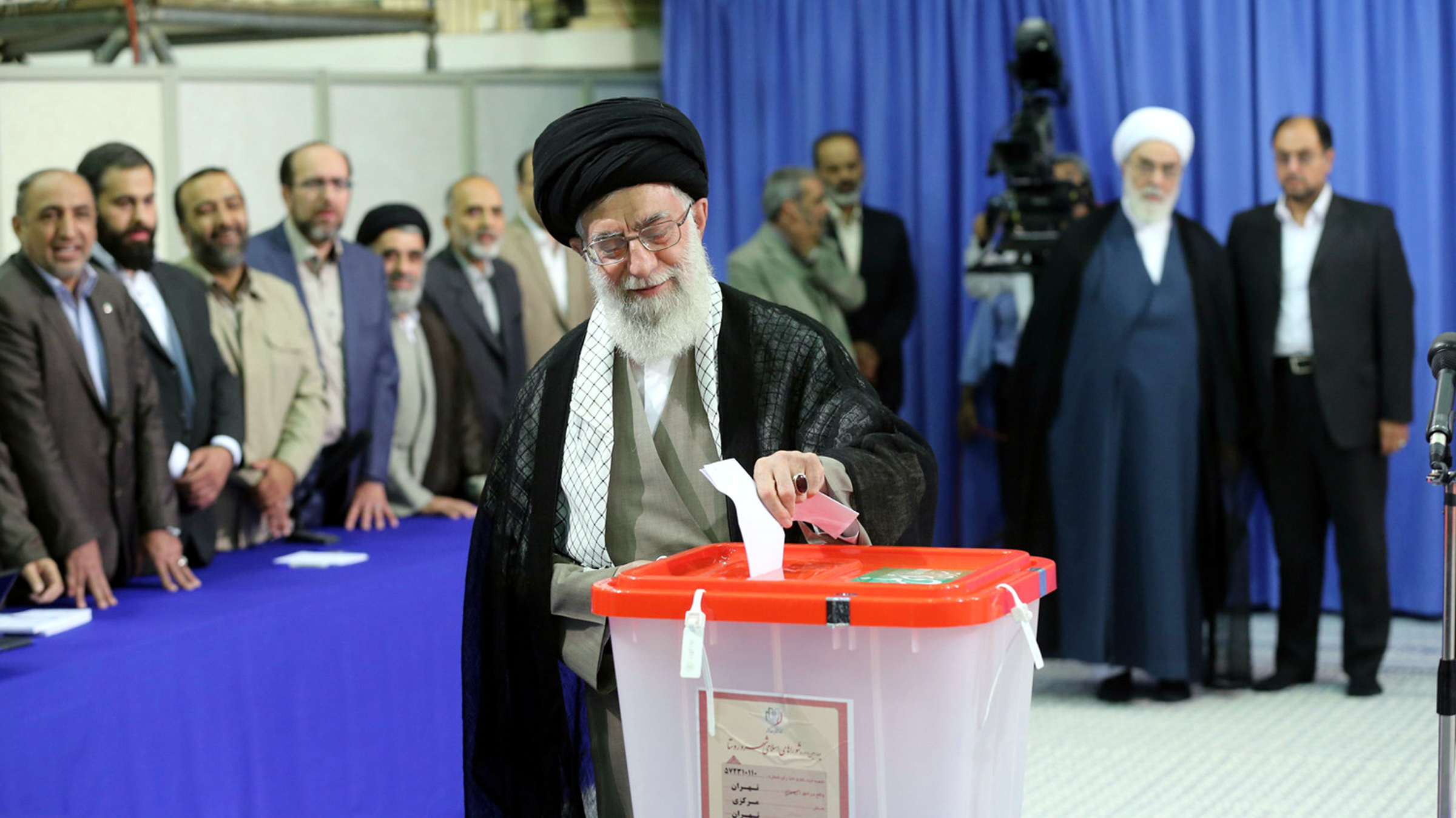 Iran's Supreme Leader Ayatollah Ali Khamenei casts his ballot at his office during the Iranian presidential election in central Tehran June 14, 2013. Iranians voted for a new president on Friday urged by Khamenei to turn out in force to discredit suggestions by arch foe the United States that the election would be unfair.
