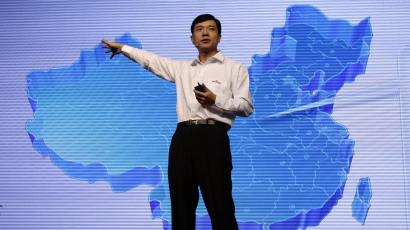 Robin Li, founder and chief executive of Chinese search engine Baidu, delivers a speech in front of a screen showing the map of China at the Baidu 2011 technology innovation conference in Beijing September 2, 2011. China's top search engine Baidu Inc launched a new mobile application system on Friday, seeking to bolster its presence in the mobile web as competitors including Alibaba Group increase their mobile offerings. REUTERS/Jason Lee