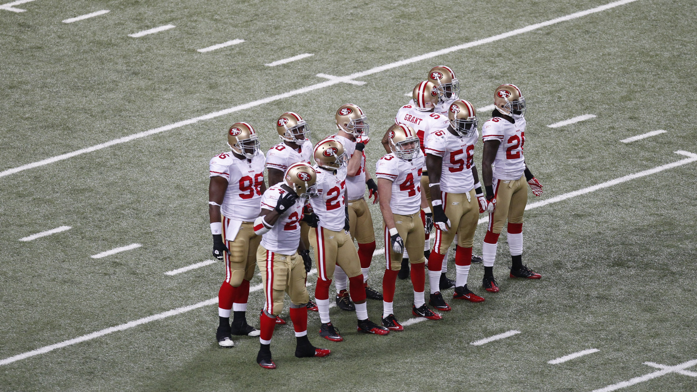 Members of the San Francisco 49ers wait for a kick off during the third quarter of an NFL football game against the St. Louis Rams Sunday, Jan. 1, 2012, in St. Louis.