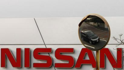 A Nissan car is reflected in a mirror outside a Nissan Motor Co factory in Yokosuka, south of Tokyo, February 9, 2009. Nissan Motor Co, Japan's No. 3 carmaker, posted a big quarterly loss on Monday and warned it would lose money this year, making its first fall into the red since Chief Executive Carlos Ghosn took the reins in 1999. REUTERS/Toru Hanai