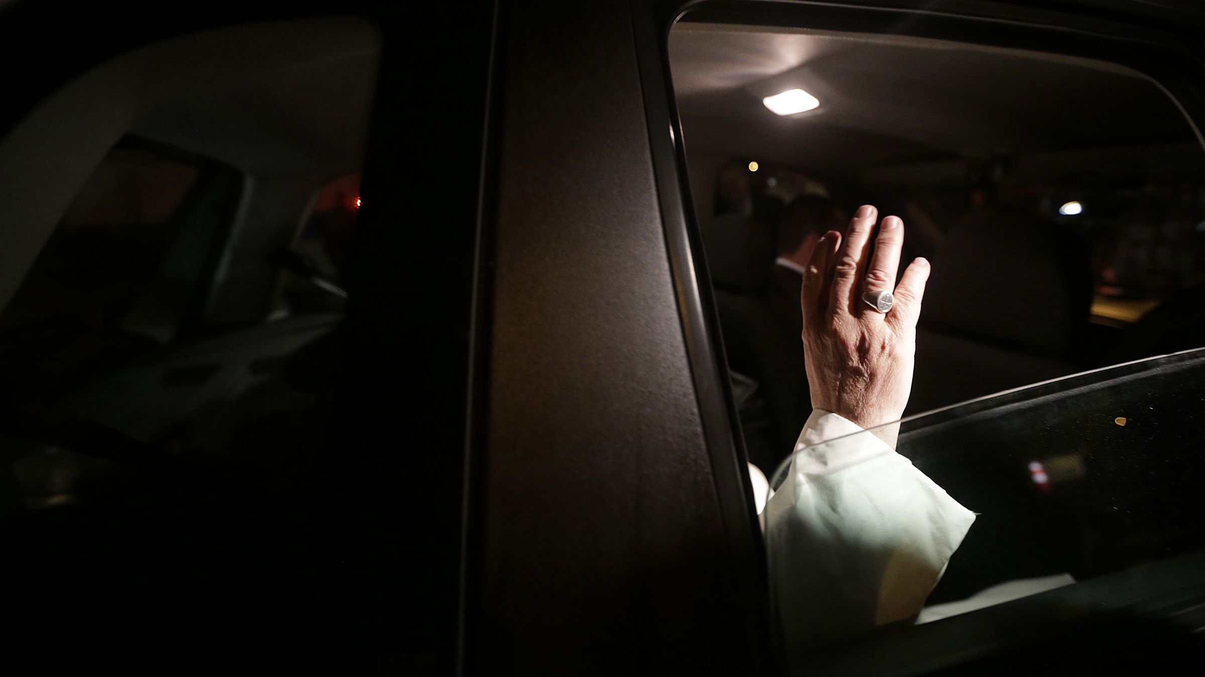Pope Francis waves as he leaves Guanabara Palace where he attended a welcoming ceremony in Rio de Janeiro, July 22, 2013. Pope Francis touched down in Rio de Janeiro on Monday, starting his first foreign trip as pontiff and a weeklong series of events expected to attract more than a million people to a gathering of young faithful in Brazil, home to the world's largest Roman Catholic population.