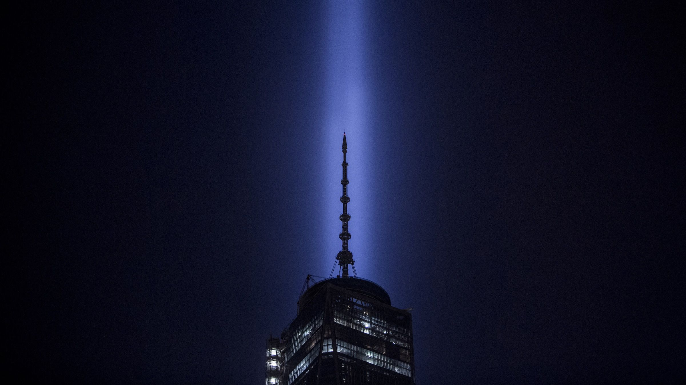 One World Trade Center and The Tribute in Lights is seen in Lower Manhattan in New York, September 11, 2013. Bagpipes, tolling bells and a reading of the names of the nearly 3,000 people who died when hijacked jetliners crashed into the World Trade Center, the Pentagon, and a Pennsylvania field marked the 12th anniversary of the September 11 attacks in 2001.  REUTERS/Gary He (UNITED STATES - Tags: SOCIETY ANNIVERSARY DISASTER) - RTX13I7J