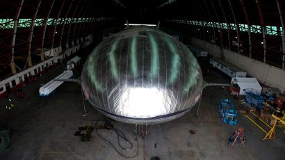 In this Jan. 24, 2013, file photo, The Aeroscraft airship, a high-tech prototype airship, is seen inside a World War II-era hangar in Tustin, Calif. The $35 million lighter-than-air dirigible was damaged and began leaking helium when part of the hangar roof collapsed Monday, Oct. 7, 2013, at a former Marine base in Southern California, authorities said. The partial collapse was reported just after 7:45 a.m. at one of the World War II-era blimp hangars on the grounds of the former Marine Corps Air Station in Tustin, said Capt. Steve Concialdi of the Orange County Fire Authority.