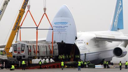 A rail carriage is loaded into an Antonov 124 cargo aircraft in Parchim, February 25, 2009. On Wednesday the first of four Bombardier Movia Metro Vehicles will be delivered to Delhi in India.