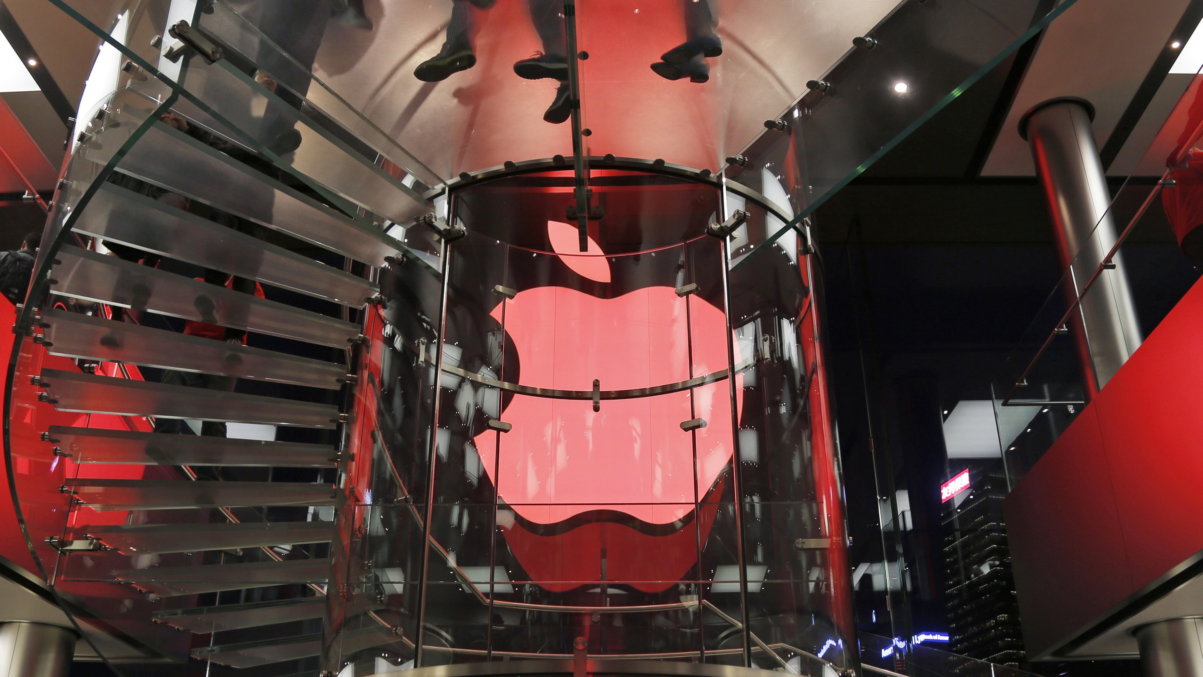 Apple store changes its logo color to red as supporting for those living with HIV during the World AIDS Day Sunday, Dec. 1, 2013. (AP Photo/Kin Cheung)
