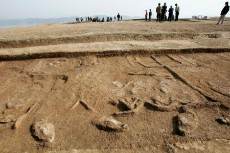 A general view of a peninsula which contains vehicles and horse bones from the Eastern Zhou dynasty (770 BC-221 BC) in Yunxian county, central China's Hubei province December 18, 2006. The peninsula will be submerged during the Middle Route of the South-to-North Water Diversion Project and archaeologists are trying to rescue it before submergence, local media reported. Picture taken December 18, 2006. CHINA OUT REUTERS/Stringer (CHINA) - RTR1KJTL