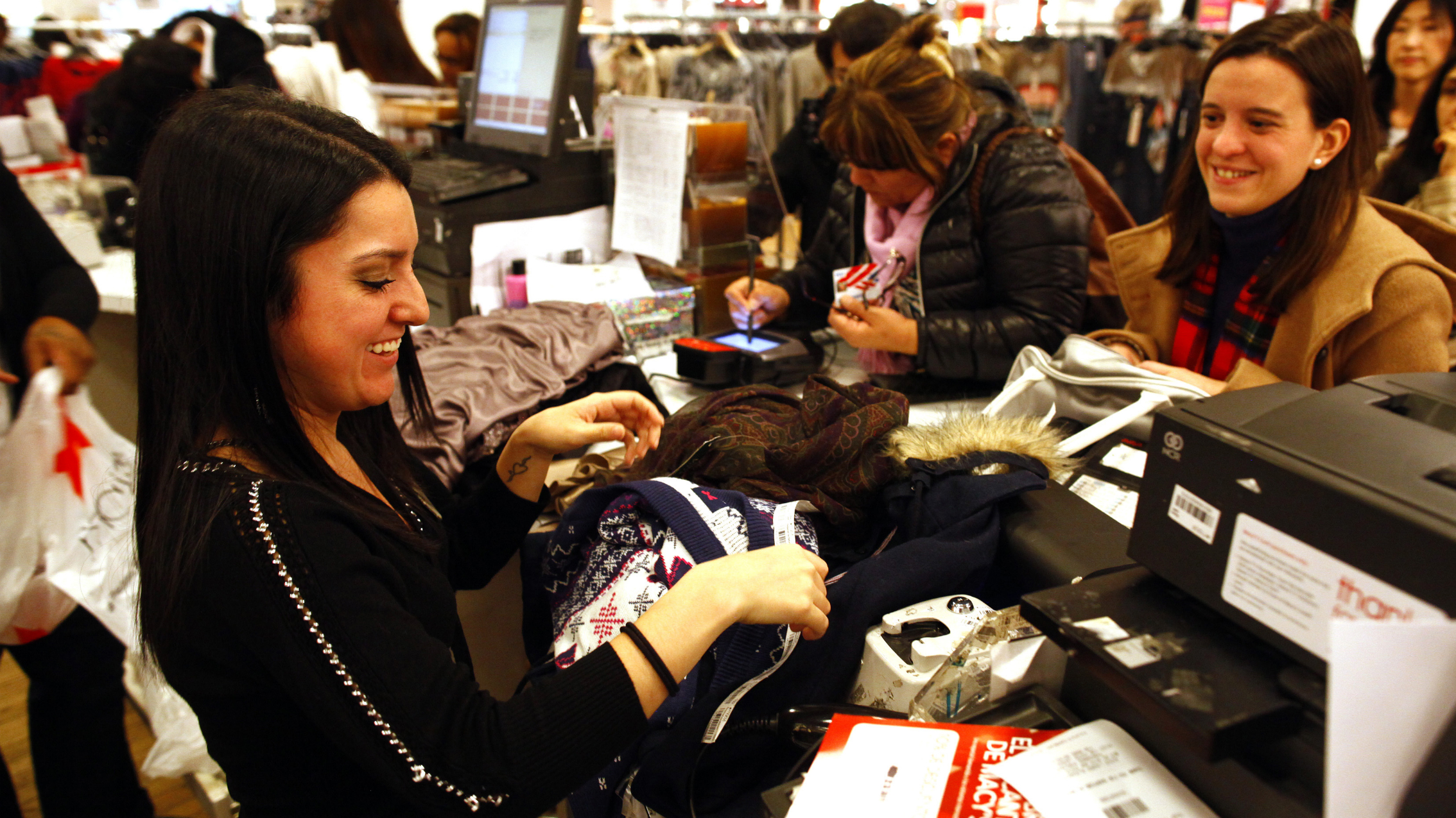 """Customers shop at Macy's department store in New York November 25, 2011. Stores looking to grab as big a piece as possible of what is expected to be a middling holiday shopping season pushed post-Thanksgiving openings into Thursday evening, getting an early start on """"Black Friday,"""" the traditional start to the U.S. holiday shopping season. REUTERS/Eric Thayer"""