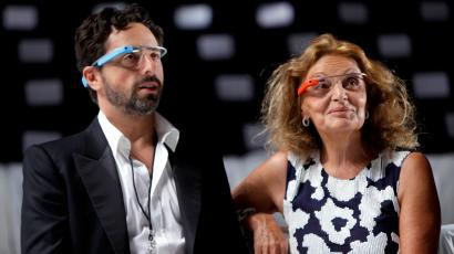 Diane Von Furstenberg watches a practice run of her Spring 2013 show with Google co-founder Sergey Brin during Fashion Week in New York, Sunday, Sept. 9, 2012. Both are wearing Google Glass, headwear that contains electronics such as a computer processor and a camera.