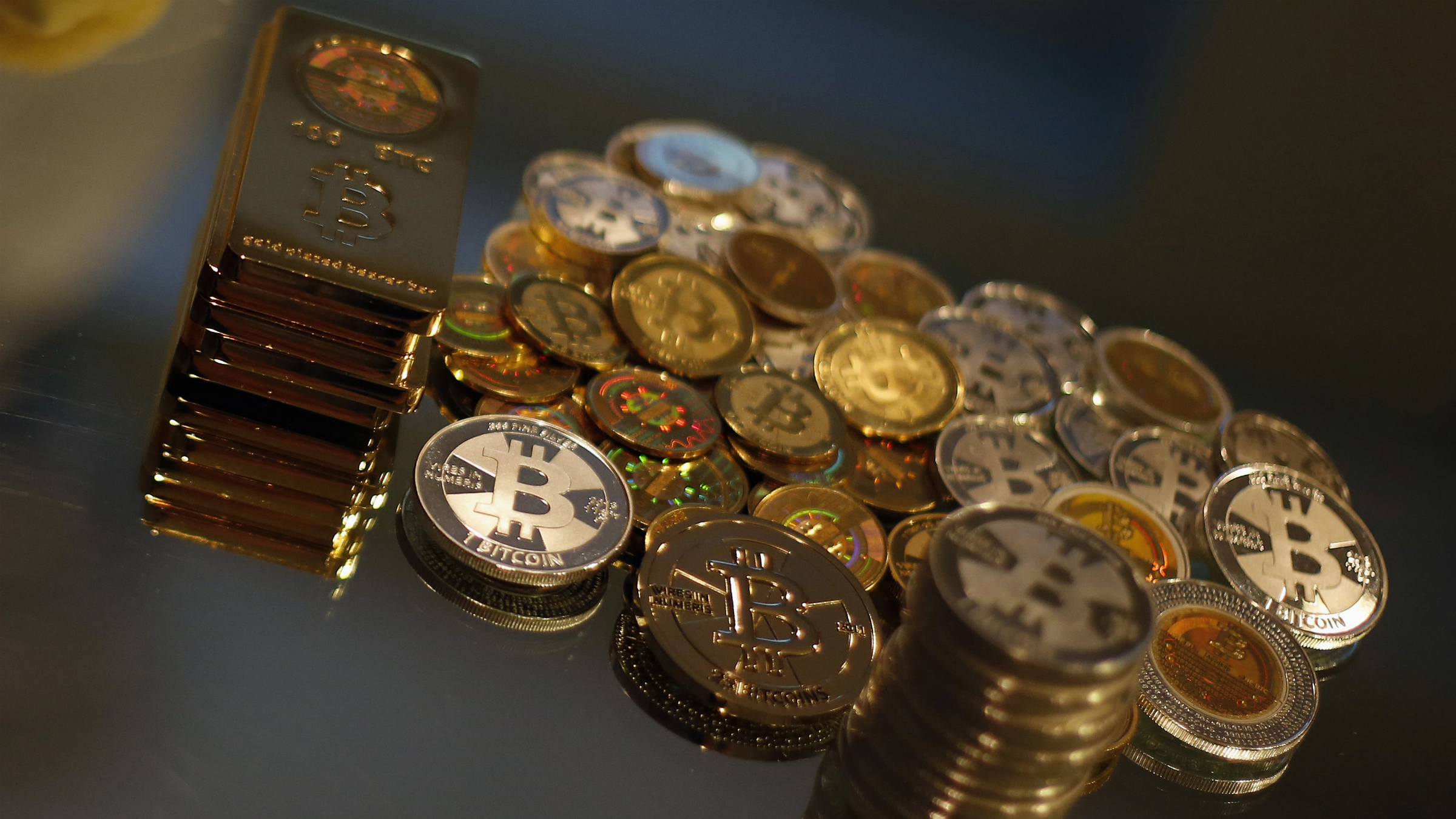 Some of Bitcoin enthusiast Mike Caldwell's coins in this photo illustration at his office in Sandy, Utah, September 17, 2013.Caldwell produces physical coins Bitcoins, which have been around since 2008, and have become a form of electronic money that can be exchanged without using traditional banking or money transfer systems. Bitcoins, touted by some experts as the future of money, gained in prominence during Europe's financial crisis as more people questioned the safety of holding their cash in the bank. REUTERS/Jim Urquhart
