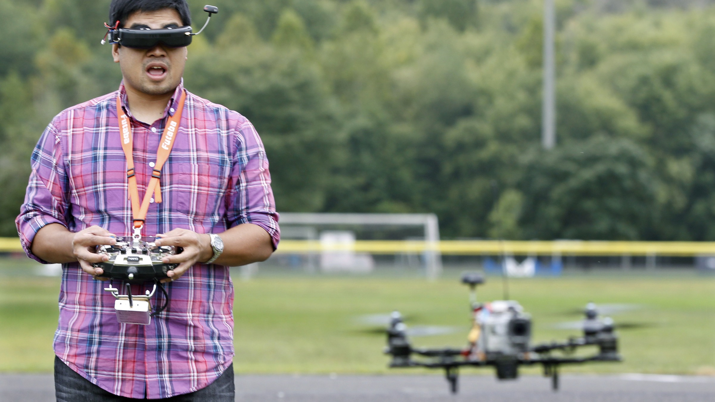 """Kevin Vertucio, of Bristol, Pa., practices flying his """"quadcopter"""" while wearing goggles connected to a camera on the craft, in Yardley, Pa., Tuesday morning, Sept. 10, 2013. Trained as an electrical engineer, Vertucio, uses the aircraft to make aerial photographs for casinos and other companies. (AP Photo/Mel Evans)"""