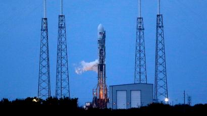 A Falcon 9 SpaceX rocket sits on Launch Complex 40 just before the launch window opened at the Cape Canaveral Air Force Station in Cape Canaveral, Fla., Monday, Nov. 25, 2013. The launch was scrubbed near the end of the launch window and will be rescheduled.