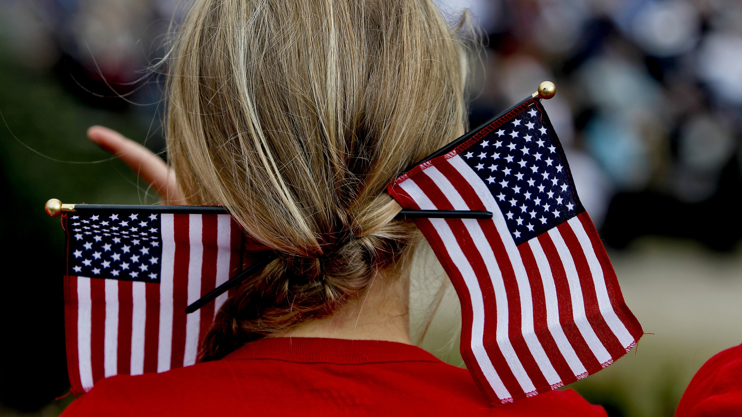 A woman has the Stars and Stripes woven into her hair as people participate in the Danish-American Rebild Celebration in Rebild, Denmark, Thursday July 4, 2013. The Rebild organization celebrates American Independence Day each year, and Danes in American still make the trip back to the old country to participate in the festival. (AP Photo/Polfoto, Rene Schutze) DENMARK OUT