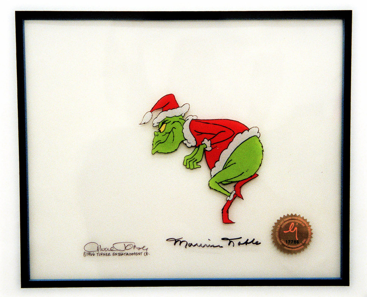 The Dr. Seuss character Grinch creeps toward a Christmas tree in this original animation cell recovered by New York City police in New York Friday, Aug. 13, 1999. The cell was recovered Friday after it showed up for auction on the eBay Web site on the Internet. Morales Stroud, 18, and Angela Rodriguez, 20, both of New York, were arrested on charges of grand larceny and criminal possession of stolen property.