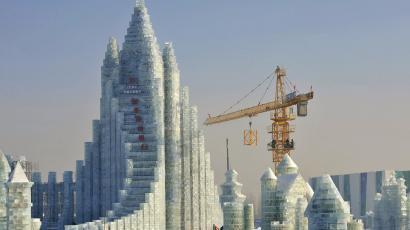 Workers and a crane are seen next to a newly-built ice sculpture of a castle ahead of the 30th Harbin Ice and Snow Festival, in Harbin, Heilongjiang province December 27, 2013. According to the festival organizers, nearly 10,000 workers were employed to build the ice and snow sculptures, which require about 180,000 square metres of ice and 150,000 square metres of snow. The festival kicks off on January 5, 2014.