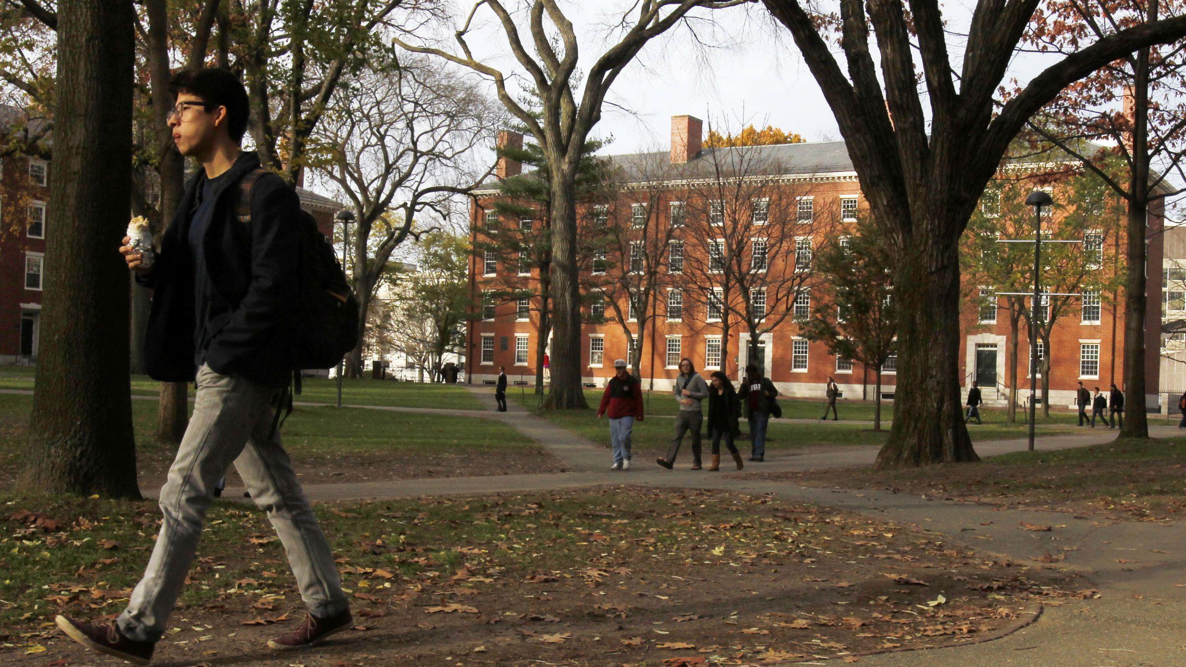 A man walks through Harvard Yard at Harvard University in Cambridge, Massachusetts.