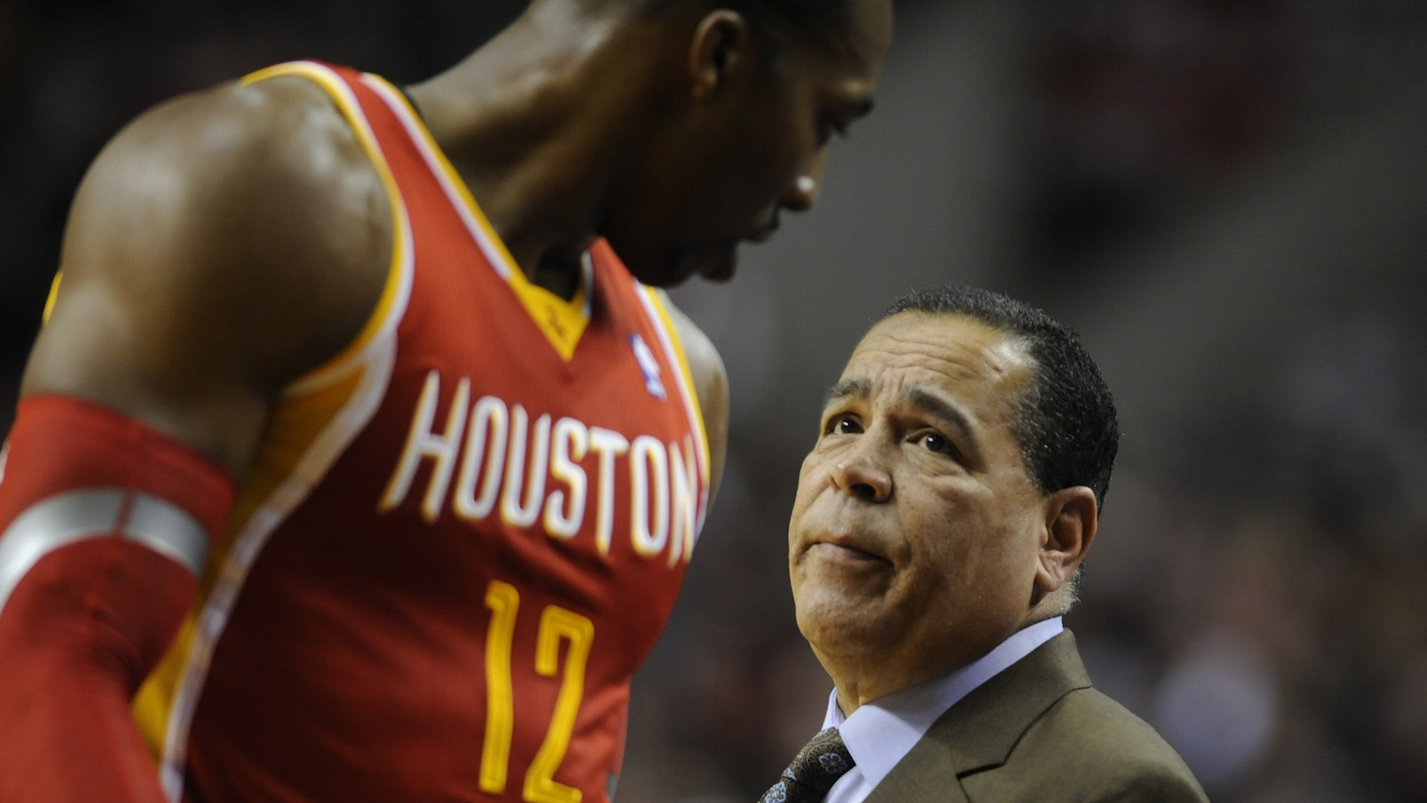 Houston Rockets assistant coach Kelvin Sampson speaks with Dwight Howard (12) during an NBA basketball game in Portland, Ore.,Thursday Dec. 12, 2013.  (AP Photo/Greg Wahl-Stephens)