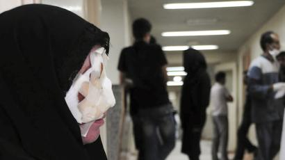 Reuters and other foreign media are subject to Iranian restrictions on leaving the office to report, film or take pictures in Tehran. A survivor of the bomb blasts sits at a corridor of a hospital in Zahedan, 1076 km (668 miles) southeast of Tehran July 16, 2010. Two rebel suicide bombers killed at least 28 people, including elite Revolutionary Guards, at a prominent Shi'ite Muslim mosque in southeast Iran, weeks after a Sunni rebel leader was hanged in the region. REUTERS/Fars News/Ali Azimzadeh
