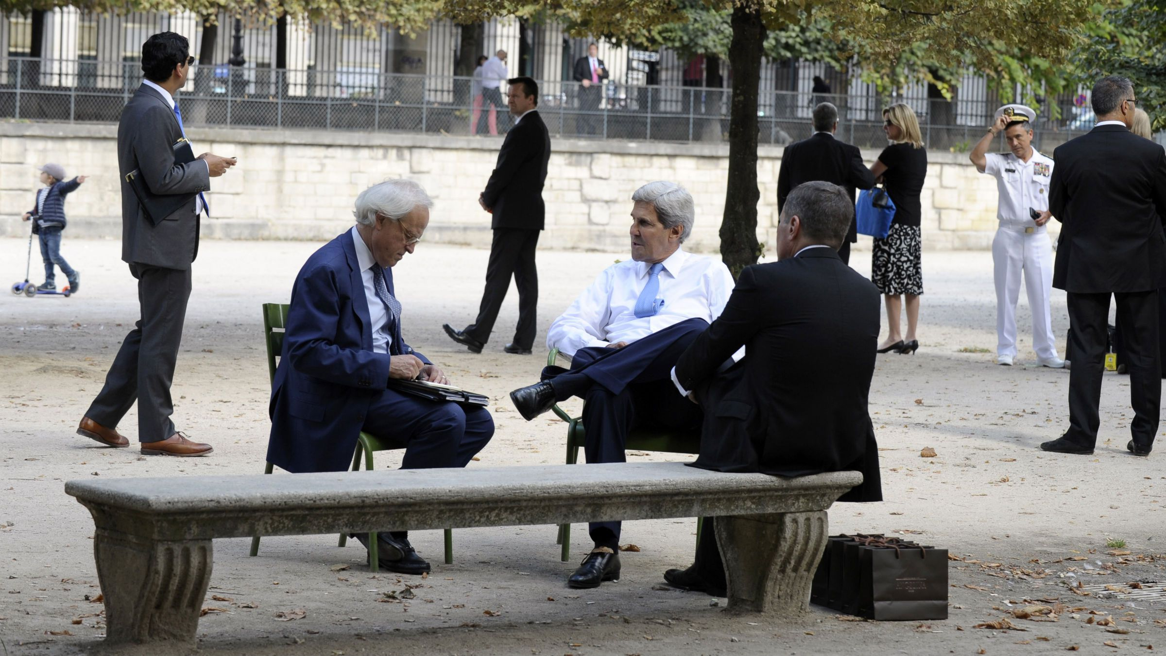 U.S. Secretary of State John Kerry (C) sits with U.S. Ambassador to France Charles Rivkin (R) and U.S. Special Envoy for Israeli-Palestinian negotiations Martin Indyk (L) at Les Tuilleries park in Paris September 8, 2013.