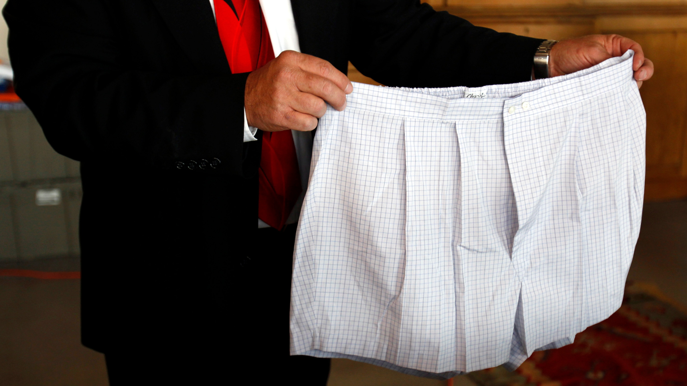 A pair of boxer shorts belonging to Bernard Madoff are displayed by an auctioneer during a media preview of the U.S. Marshals Service 'Madoff II Auction' in the Brooklyn borough of New York November 10, 2010. More than 400 pieces of personal property, jewelry, and antiques from Madoff and his wife, Ruth, will be sold at the auction in New York City on November 13, 2010. The property was forfeited and seized in connection with the criminal prosecution of Madoff by the United States Attorney's Office and the proceeds from the auction will be deposited in the United States Department of Justice Asset Forfeiture Fund to compensate the victims of the multi-billion dollar scam, according to a release from the U.S. Marshals Service.