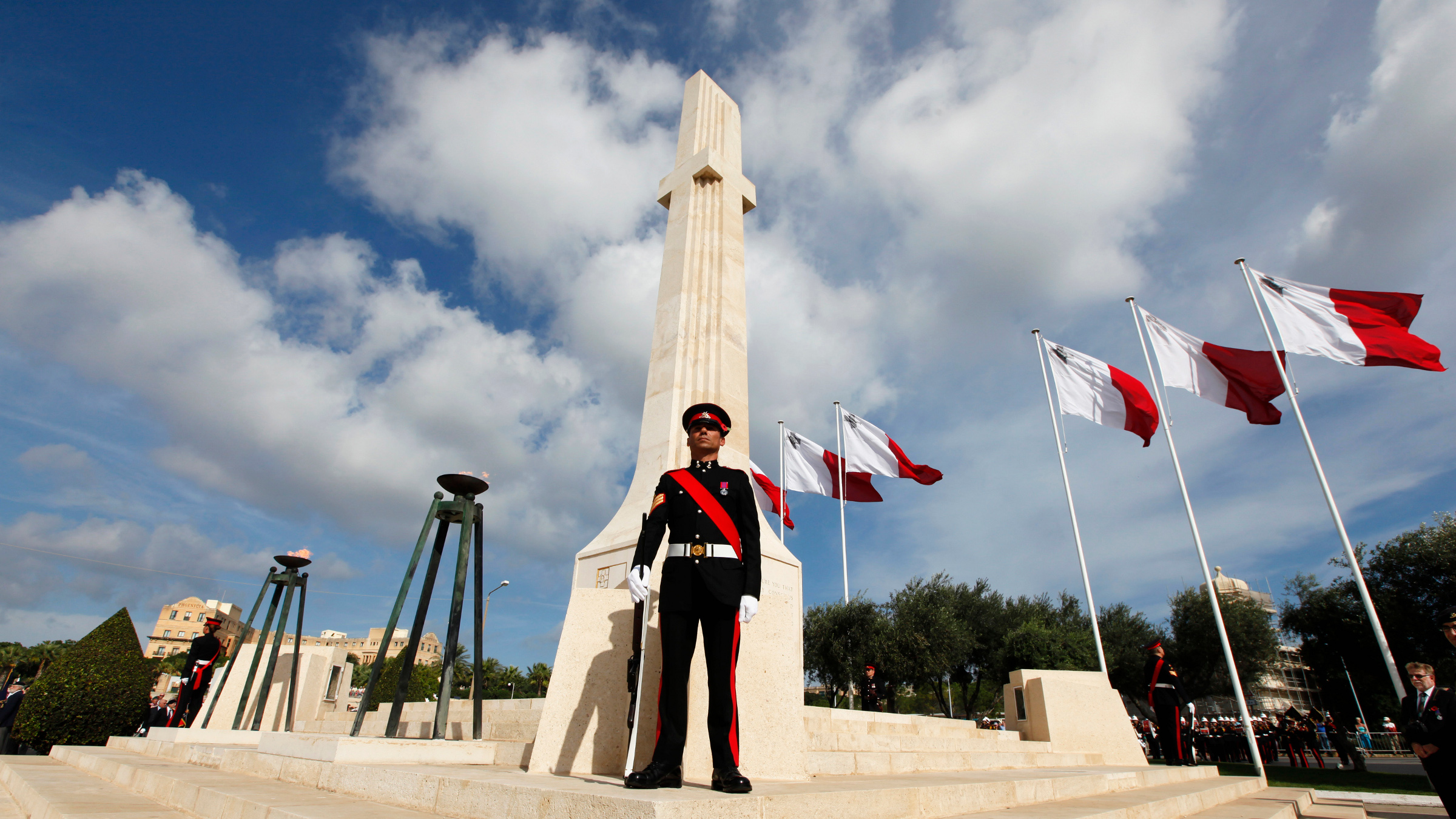 Armed Forces of Malta soldiers stand by the War Memorial cenotaph during a Remembrance Day memorial service in Floriana, on the outskirts of Valletta, November 10, 2013. Representatives of the Commonwealth observed two minutes silence on Remembrance Sunday to commemorate members of the armed forces who were killed during both World Wars.