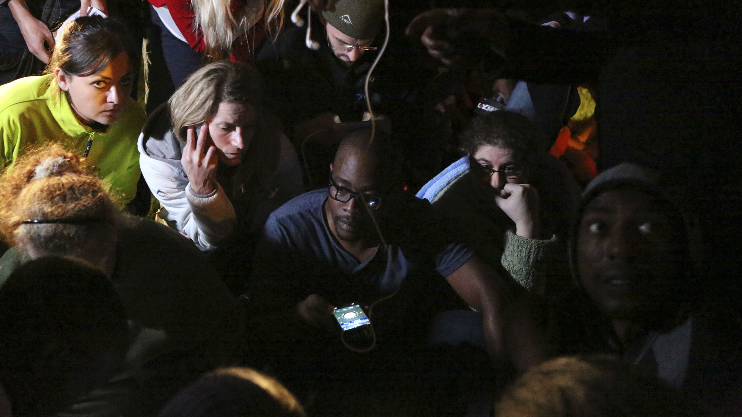 eople listen to a radio as South African President Jacob Zuma announces the death of former South African President Nelson Mandela in Houghton, December 5, 2013. Mandela died peacefully at his Johannesburg home on Thursday after a prolonged lung infection, Zuma said. Mandela, the country's first black president and anti-apartheid icon known in South Africa by his clan name of Madiba, emerged from 27 years in apartheid prisons to help guide South Africa through bloodshed and turmoil to democracy.