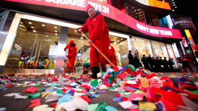 Workers begin cleaning up the confetti that was dropped on revelers at midnight during New Year's Eve celebrations in Times Square in New York January 1, 2013.