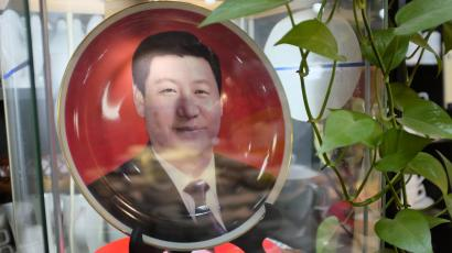 A portrait of Chinese President and General Secretary of the Communist Party of China, Xi Jinping, is seen on a porcelain plate on sale for 600 RMB ($98) at a shop in Beijing, November 5, 2013. REUTERS/Jason Lee