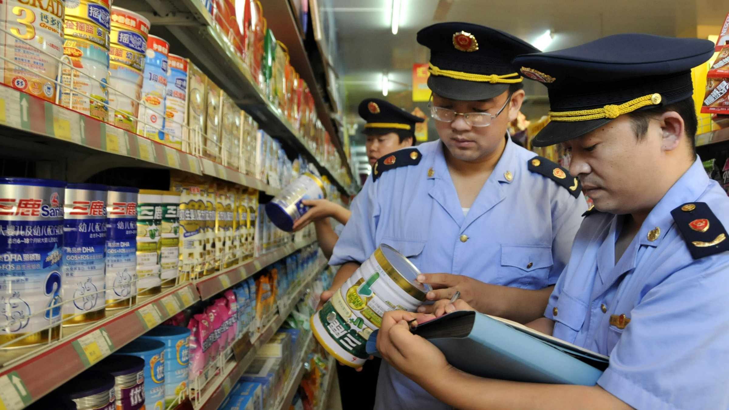 Authorities inspect Sanlu infant formula during the melamine scare of 2008.