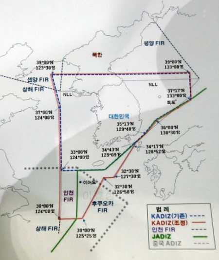 A map of South Korea and its region shows the Air Defense Identification Zone (ADIZ) set up by three east Asian nations at Defense Ministry in Seoul, South Korea, Sunday, Dec. 8, 2013. South Korea on Sunday announced expansion of its air defense zone following China's move to establish a similar zone that has been criticized by Beijing's neighbors. Green line signifies ADIZ set up by Japan as blue dotted line is ADIZ set up by South Korea before they unveiled on Sunday an expanded new ADIZ which is shown in red line. Gray dotted line in the bottom is ADIZ set up by China. Photo: Lee Jin-man, AP