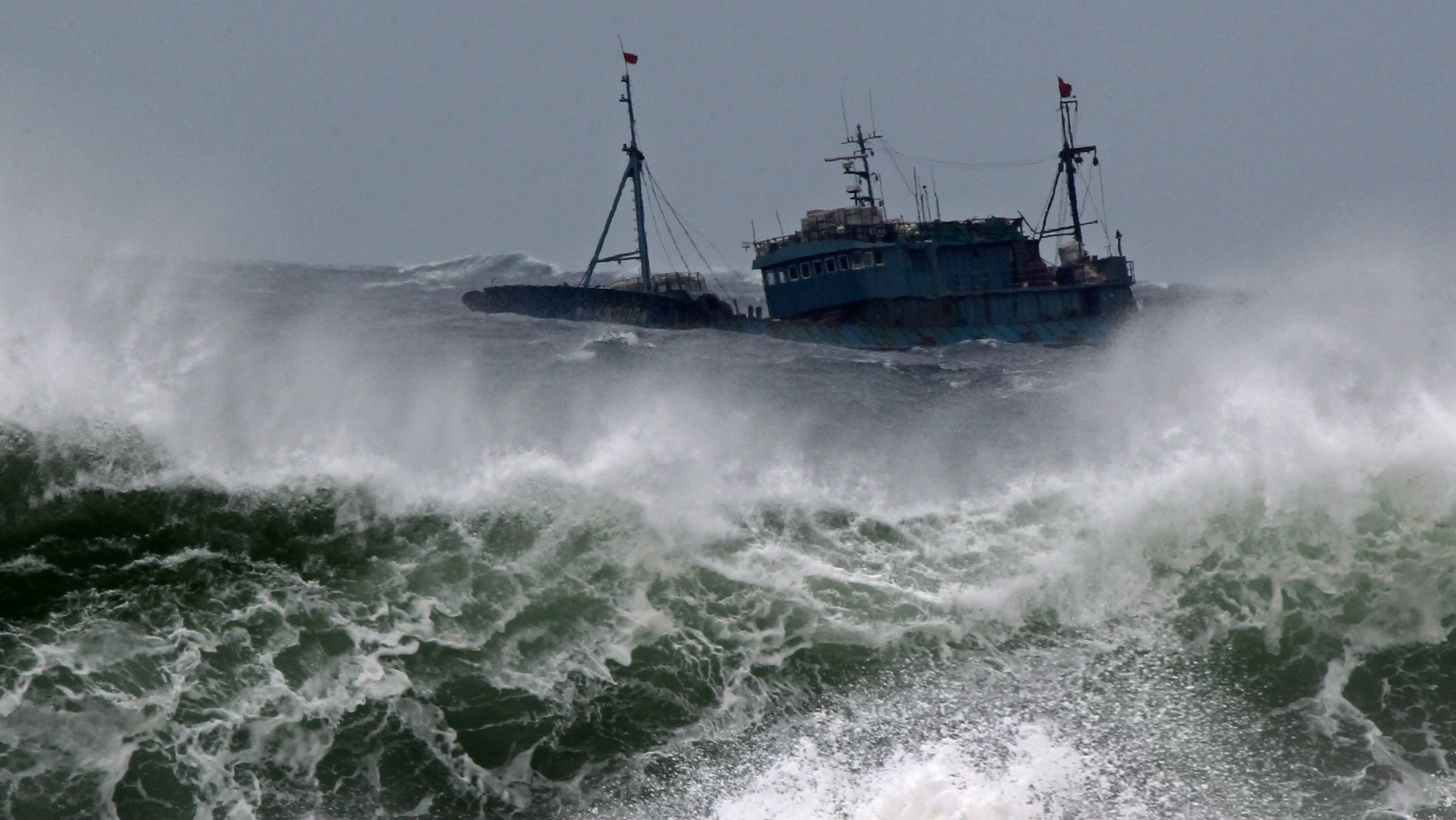 Chinese fishing boat navigates through rough waves caused by Typhoon Bolaven in waters off Seogwipo on Jeju Island, South Korea