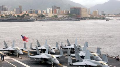 F-18 Super Hornet fighter airplanes sit on the deck of the USS Carl Vinson aircraft carrier at Guanabara Bay in Rio de Janeiro February 26, 2010. The aircraft carrier USS Carl Vinson arrived in Brazil on Friday, a few weeks after taking part in Operation Unified Response, the international humanitarian aid mission in Haiti. The ship stopped in Rio de Janeiro on its way to dock in San Diego, California.