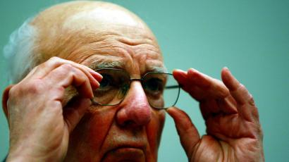 Former Federal Reserve Board Chairman Paul Volcker, who currently serves as economic adviser to President Obama, adjusts his glasses while testifying on Capitol Hill in Washington, Wednesday, March 17, 2010, before the House Financial Services Committee.
