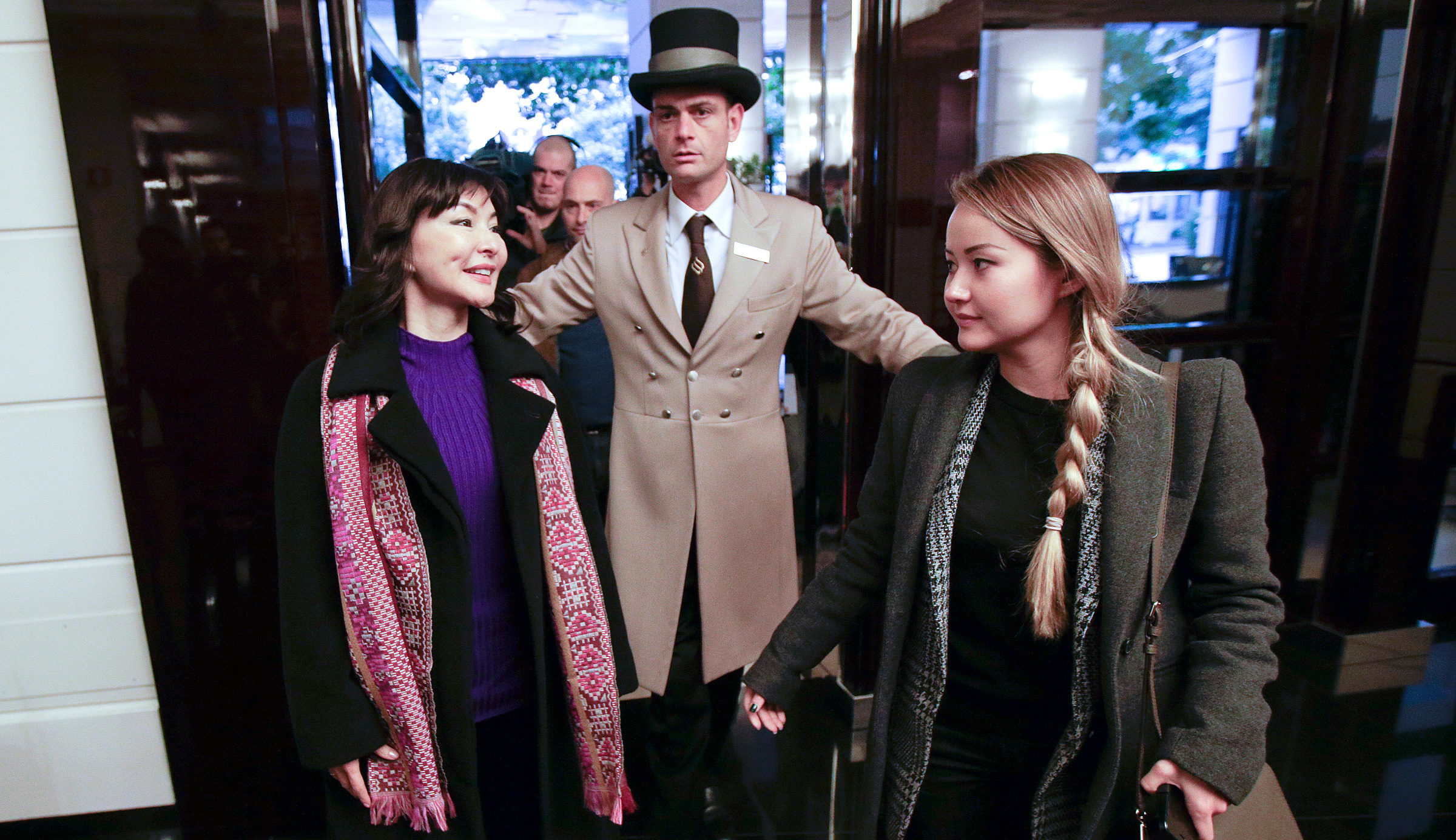 Alma Shalabayeva (L), the wife of exiled oligarch Mukhtar Ablyazov, arrives with her daughter Madina to lead a news conference in Rome December 27, 2013. Ablyazov was accused of embezzling millions of dollars from his former bank and as a result, Shalabayeva and Madina had been expelled from Rome, where they had been living, in a lightning operation in June. Shalabayeva thanked Italy on Tuesday for helping her to overturn the travel ban and persuade the Kazakh government to allow her return to Europe, the Italian foreign ministry said.