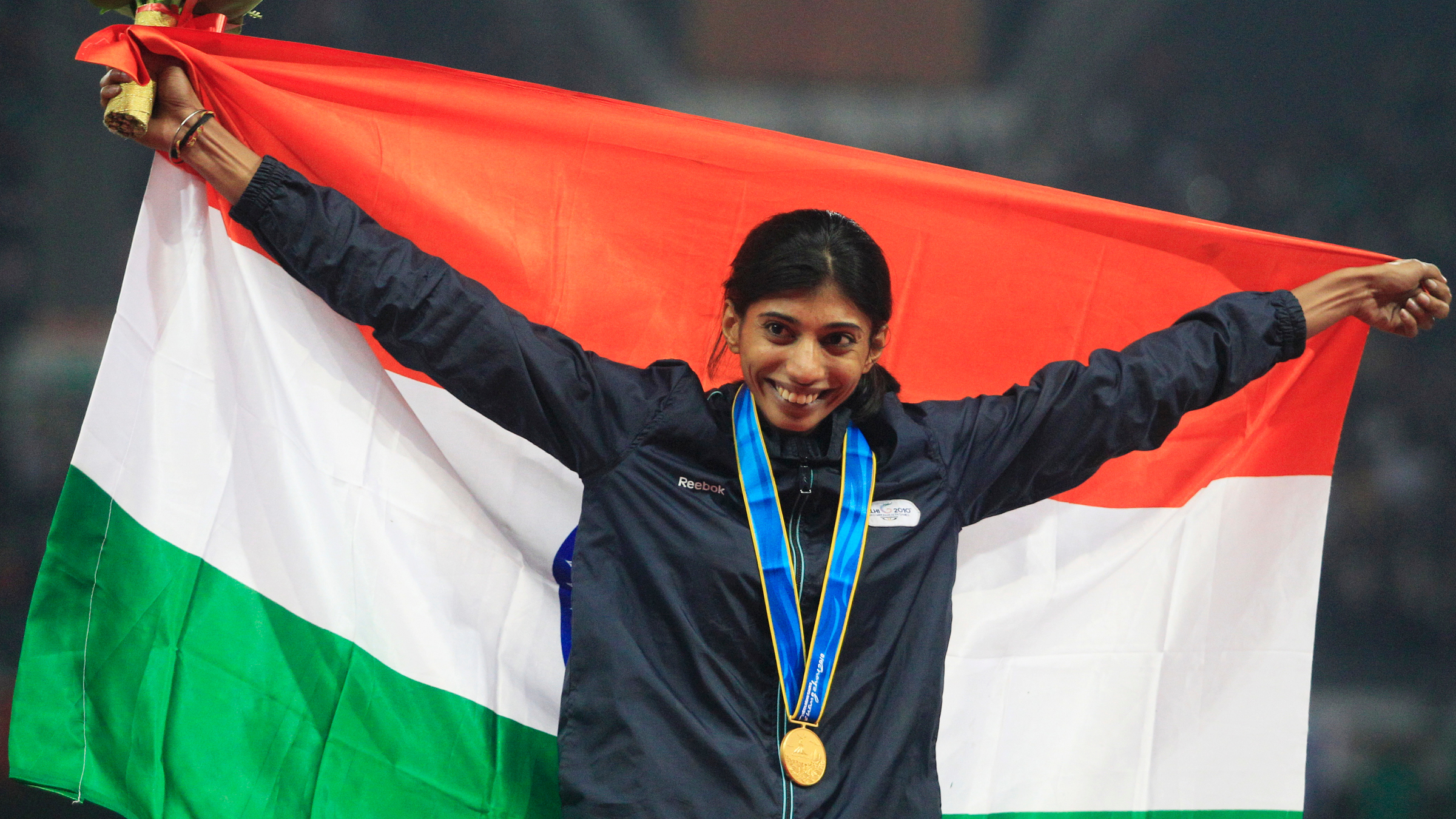 India's Ashwini Chidananda Akkunji celebrates with her gold medal after winning the women's 400m hurdles event at the 16th Asian Games in Guangzhou, Guangdong province, November 25, 2010.