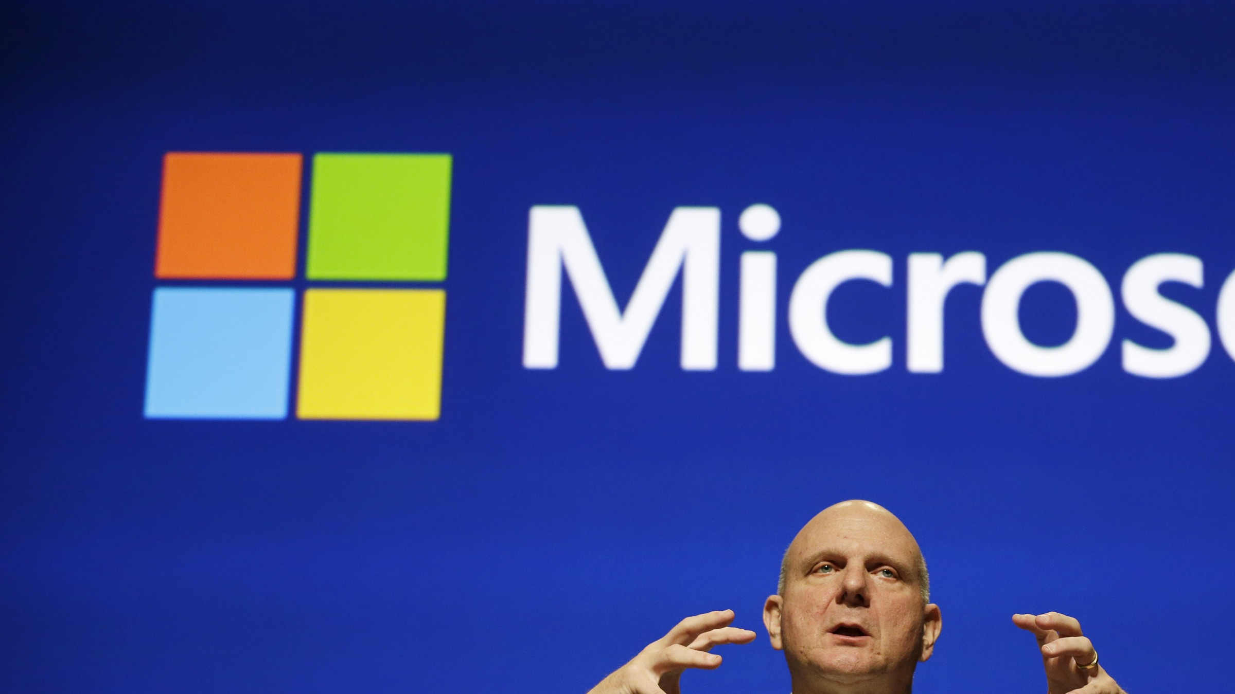 Microsoft CEO Steve Ballmer speaks at the company's annual shareholders meeting Tuesday, Nov. 19, 2013, in Bellevue, Wash. (AP Photo/Elaine Thompson)