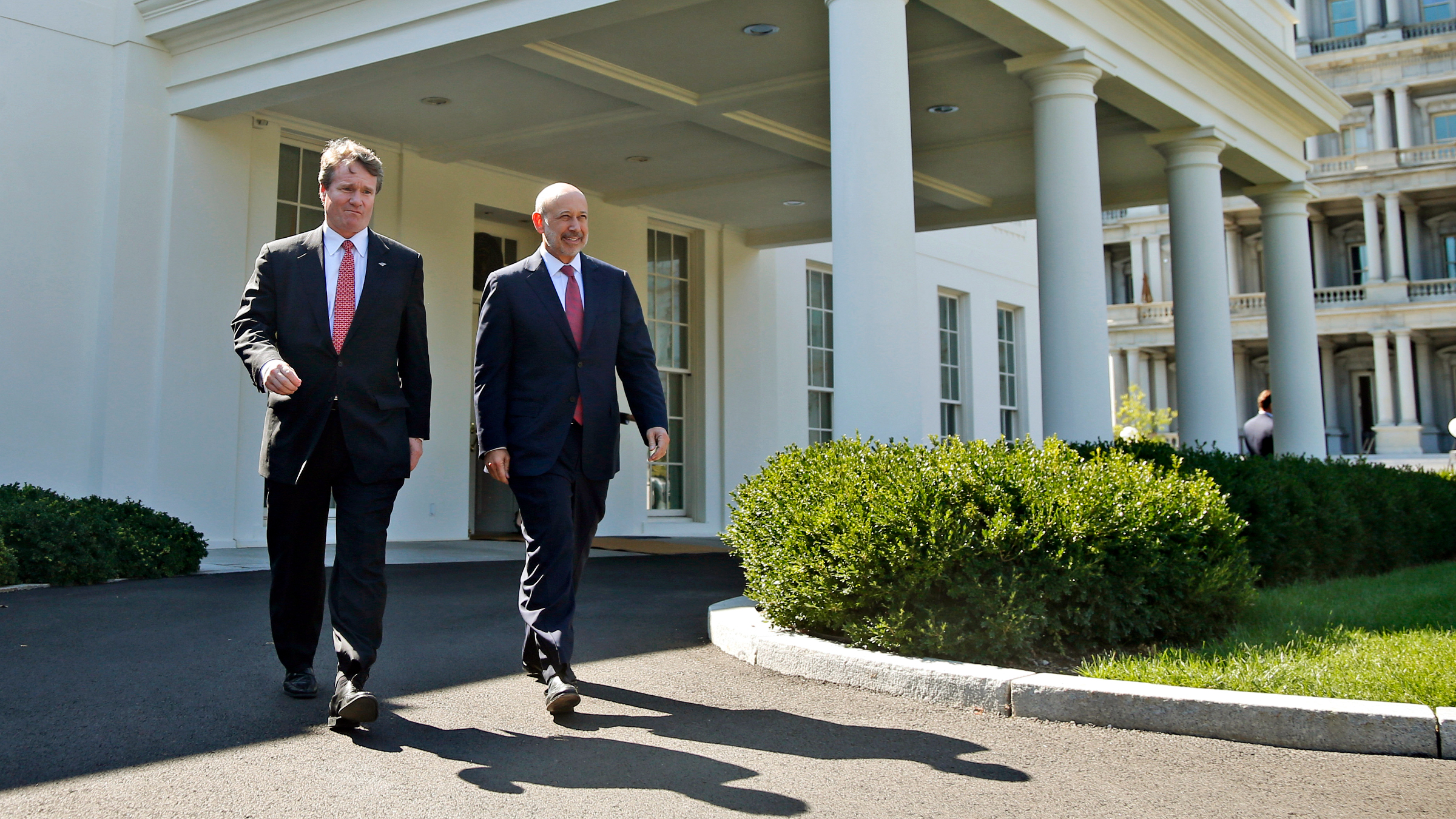 Goldman Sachs Group, Inc. Chairman and CEO Lloyd Blankfein, right, and Bank of America CEO Brian Moynihan, walk out of the West Wing of the White House in Washington, Wednesday, Oct. 2, 2013, to speak to reporters after they and other financial leaders met with President Barack Obama regarding the debt ceiling and the economy.