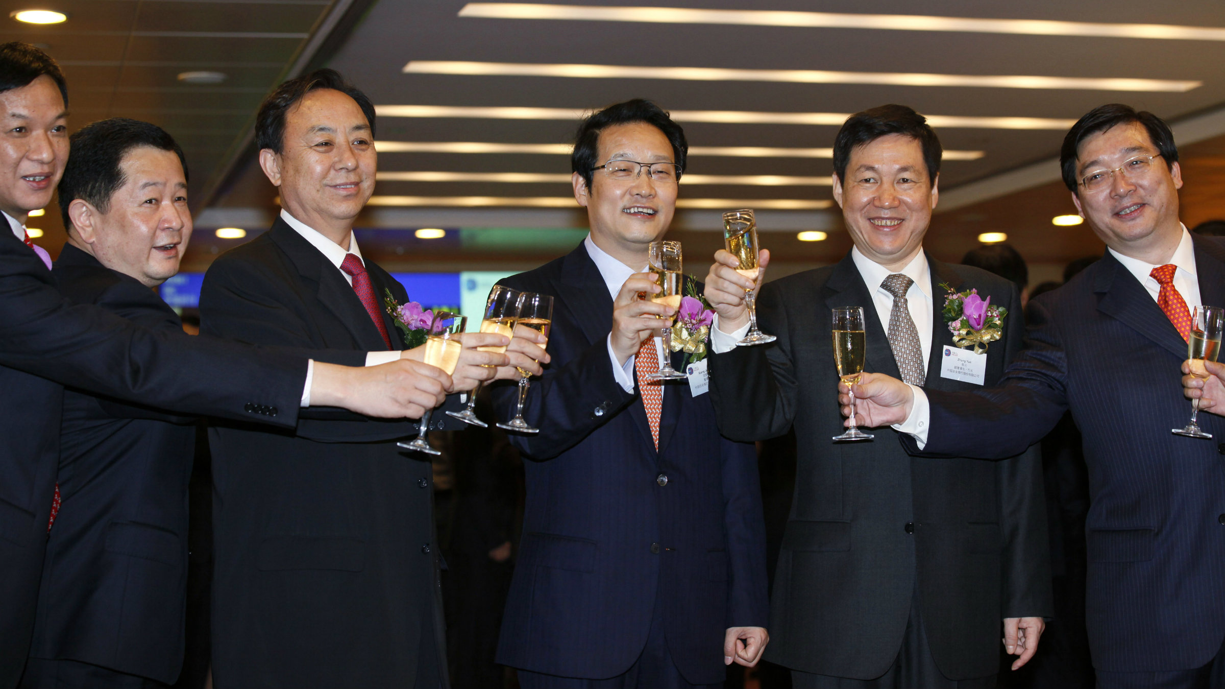 Who needs women? Agricultural Bank of China's officials celebrate their HKSE listing.