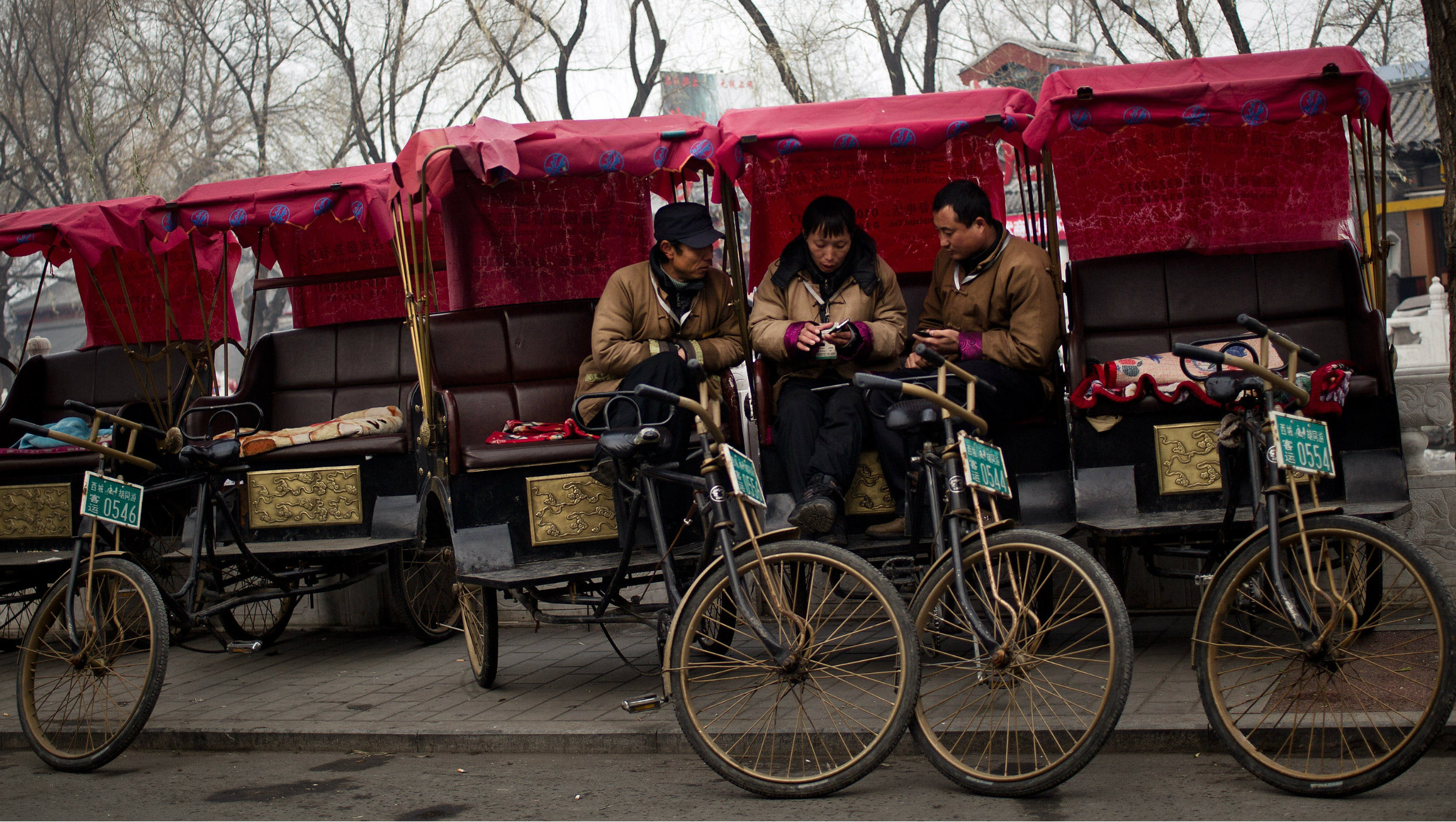 Drivers play with their mobile phones in Beijing.