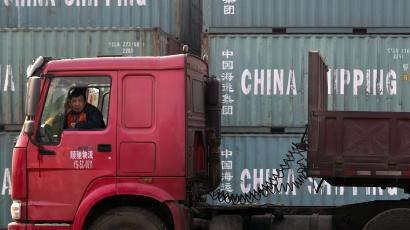 In this photo taken Monday, Feb. 20, 2012 photo, a truck driver waits to unload his cargo at the Caofeidian Port in Tangshan, in northern China's Hebei province. China says its trade rebounded in February after a Lunar New Year slowdown but a broader measure gave clear signs both global and Chinese demand are weakening. Customs data Saturday, March 10, 2012 showed exports grew 18.4 percent over a year earlier, up from January's 0.5 percent contraction. Imports jumped 39.6 percent, up from the previous month's decline of 15 percent. (AP Photo/Alexander F. Yuan