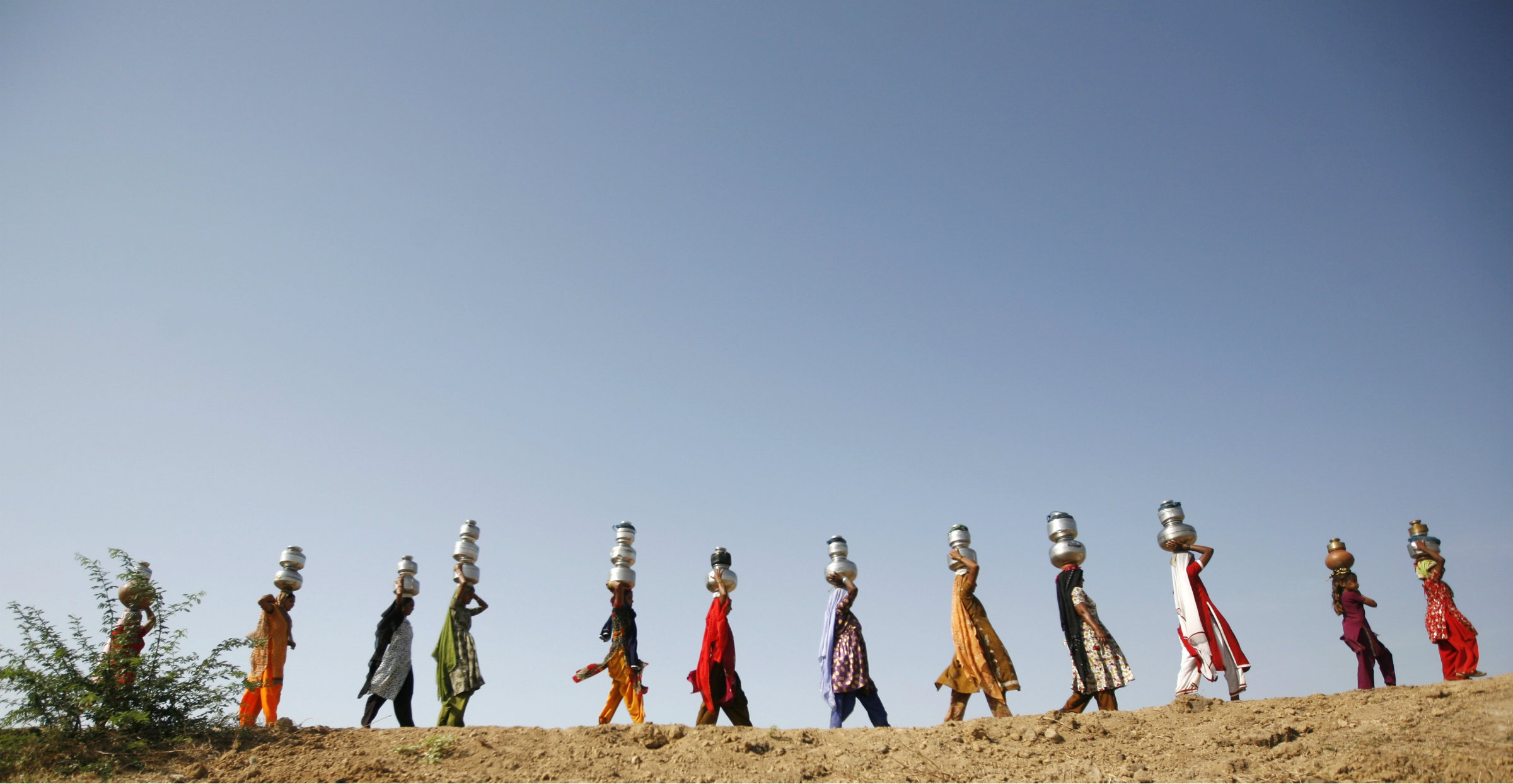 Women carry water in Meni village, Gujarat.