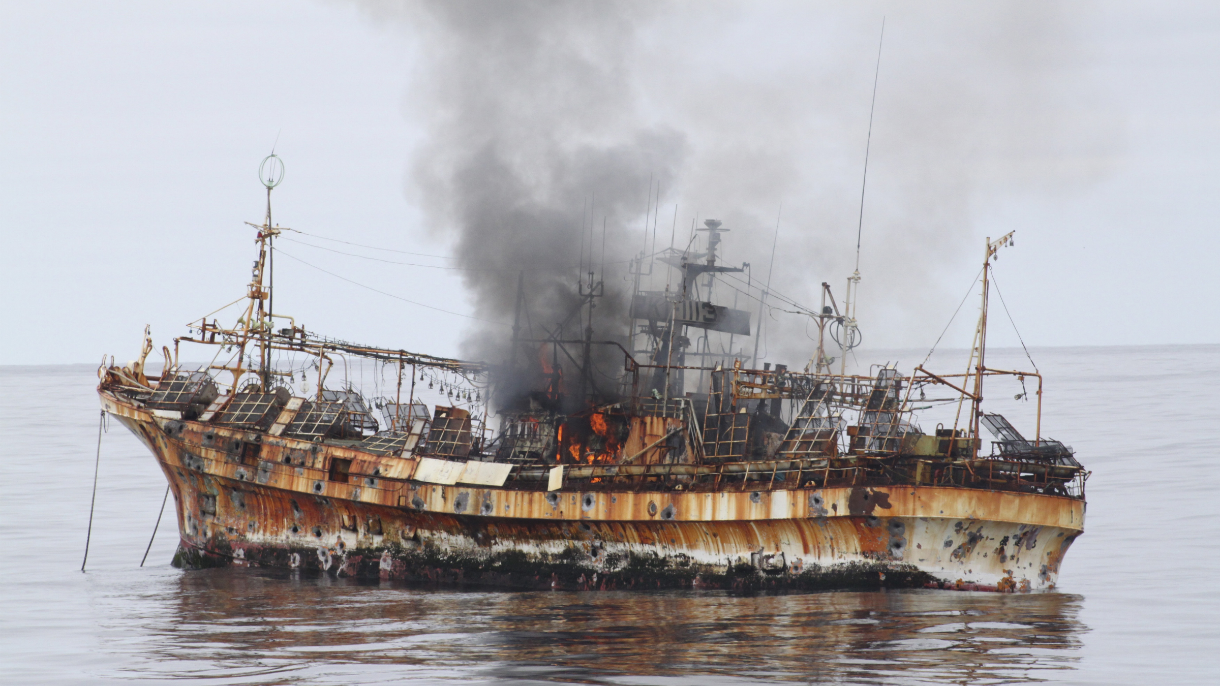 """Japanese fishing vessel, """"Ryou-Un Maru"""", shows significant signs of damage after U.S. Coast Guard Cutter Anancapa fired explosive ammunition into it, 180 miles (about 290 km) west of the Southeast Alaskan coast April 5, 2012. The U.S. Coast Guard opened fire on Thursday on a derelict Japanese fishing vessel washed out to sea by last year's devastating tsunami in a bid to sink it and eliminate a threat to navigation, a spokesman for the agency said. REUTERS/U.S. Coast Guard/Handout"""