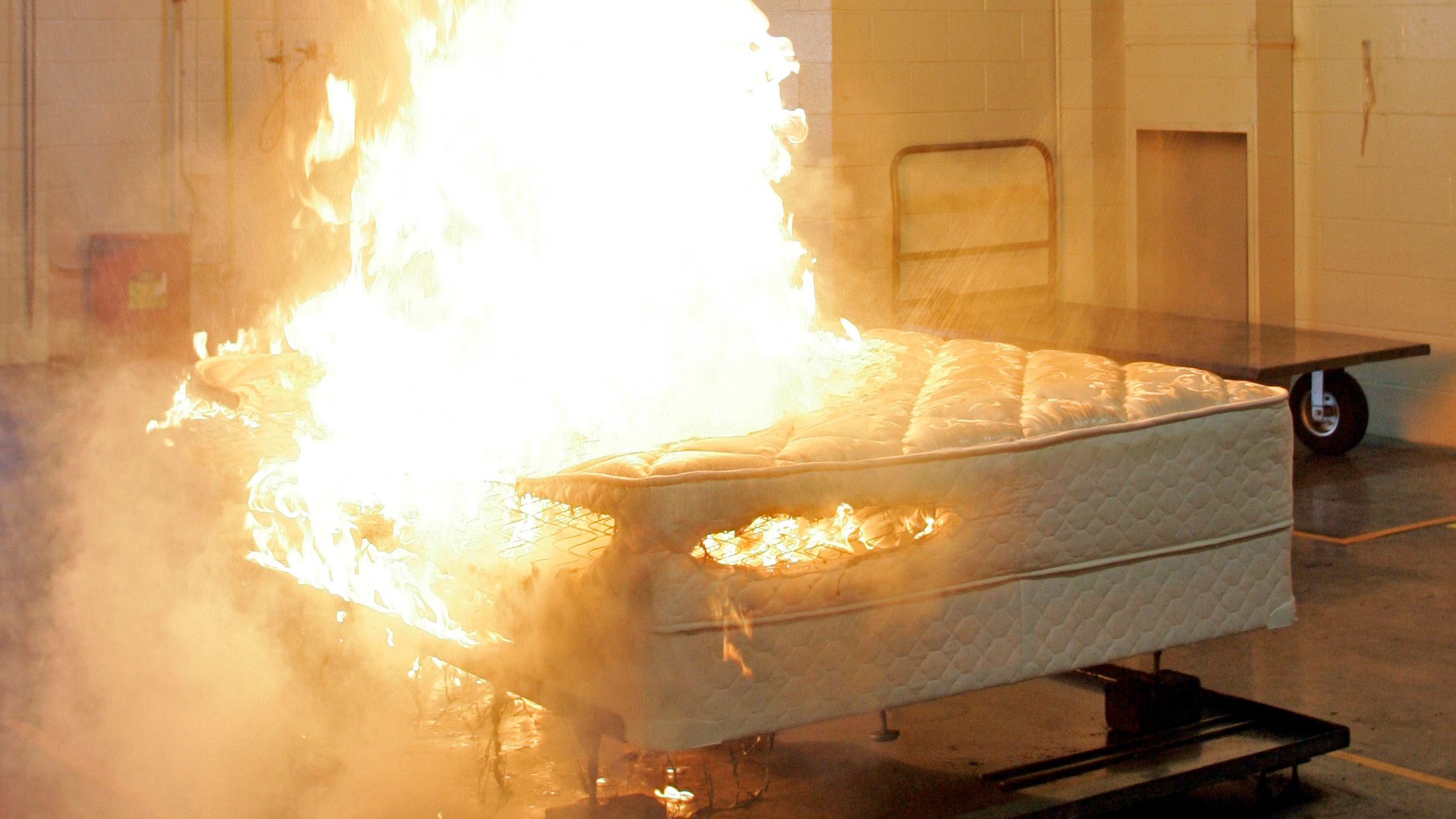 Automatic sprinklers extinguish a mattress fire at the Sealy testing lab in Trinity, N.C., Wednesday, June 20, 2007. The federal Consumer Product Safety Commission wrote new flammability standards aimed at reducing the number of mattress fires started by open flames such as candles and lighters. The commission calls it the most expensive regulation handed down to any industry in its history, and one it hopes will prevent as many as 270 deaths a year.
