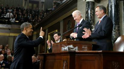 U.S. President Barack Obama (L) gestures toward Vice President Joe Biden (C) and House Speaker John Boehner (R-OH) prior to delivering his State of the Union address on Capitol Hill in Washington, February 12, 2013.