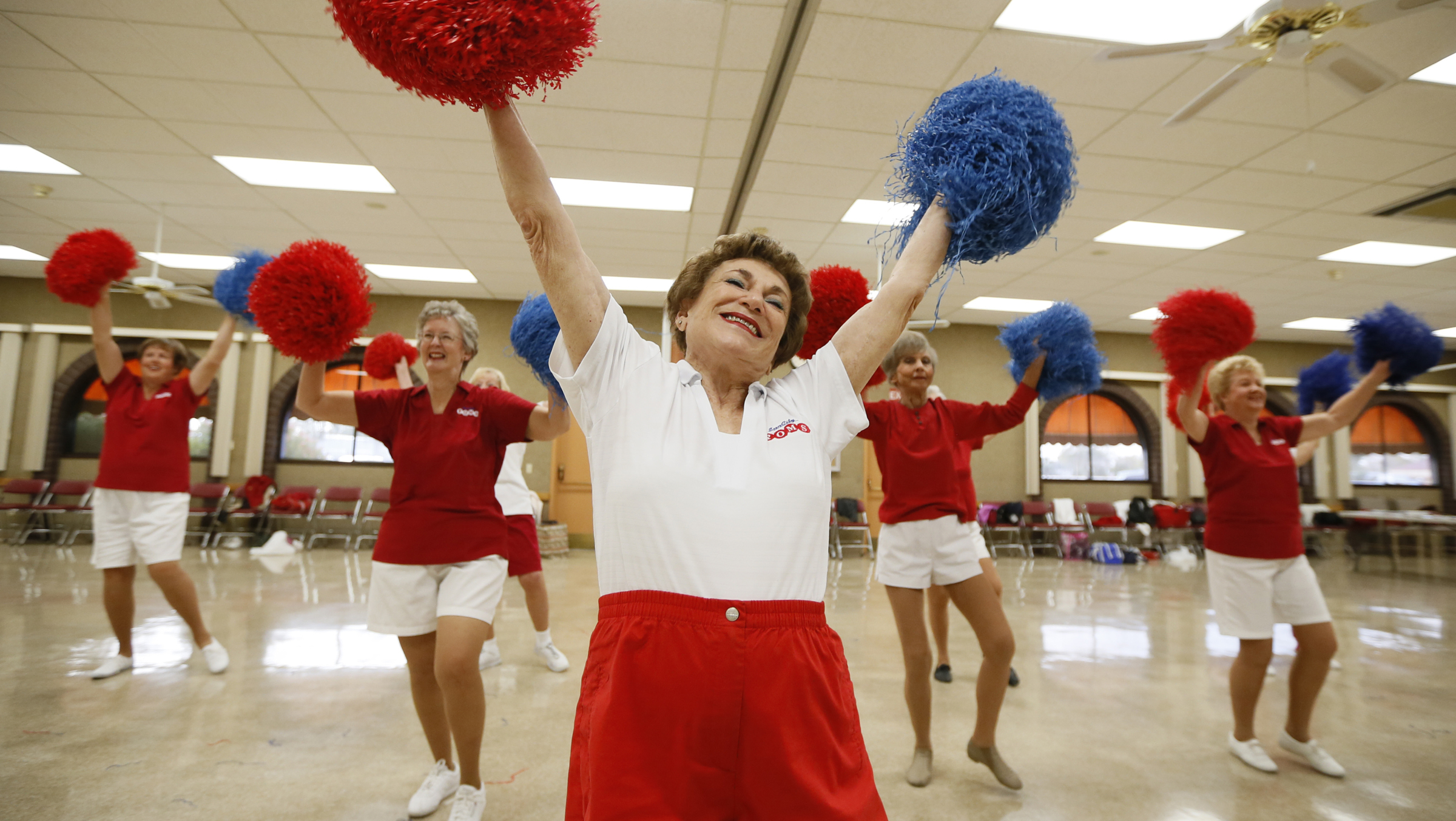 Pat Weber, 81, leads the Sun City Poms cheerleader dancers as they rehearse in Sun City, Arizona, January 7, 2013. Sun City was built in 1959 by entrepreneur Del Webb as America?s first active retirement community for the over-55's. Del Webb predicted that retirees would flock to a community where they were given more than just a house with a rocking chair in which to sit and wait to die. Today?s residents keep their minds and bodies active by socializing at over 120 clubs with activities such as square dancing, ceramics, roller skating, computers, cheerleading, racquetball and yoga. There are 38,500 residents in the community with an average age 72.4 years. Picture taken January 7, 2013.  REUTERS/Lucy Nicholson (UNITED STATES - Tags: SOCIETY TPX IMAGES OF THE DAY)  ATTENTION EDITORS - PICTURE 20 OF 30 FOR PACKAGE 'THE SPORTY SENIORS OF SUN CITY' SEARCH 'SUN CITY' FOR ALL IMAGES - RTR3CITP