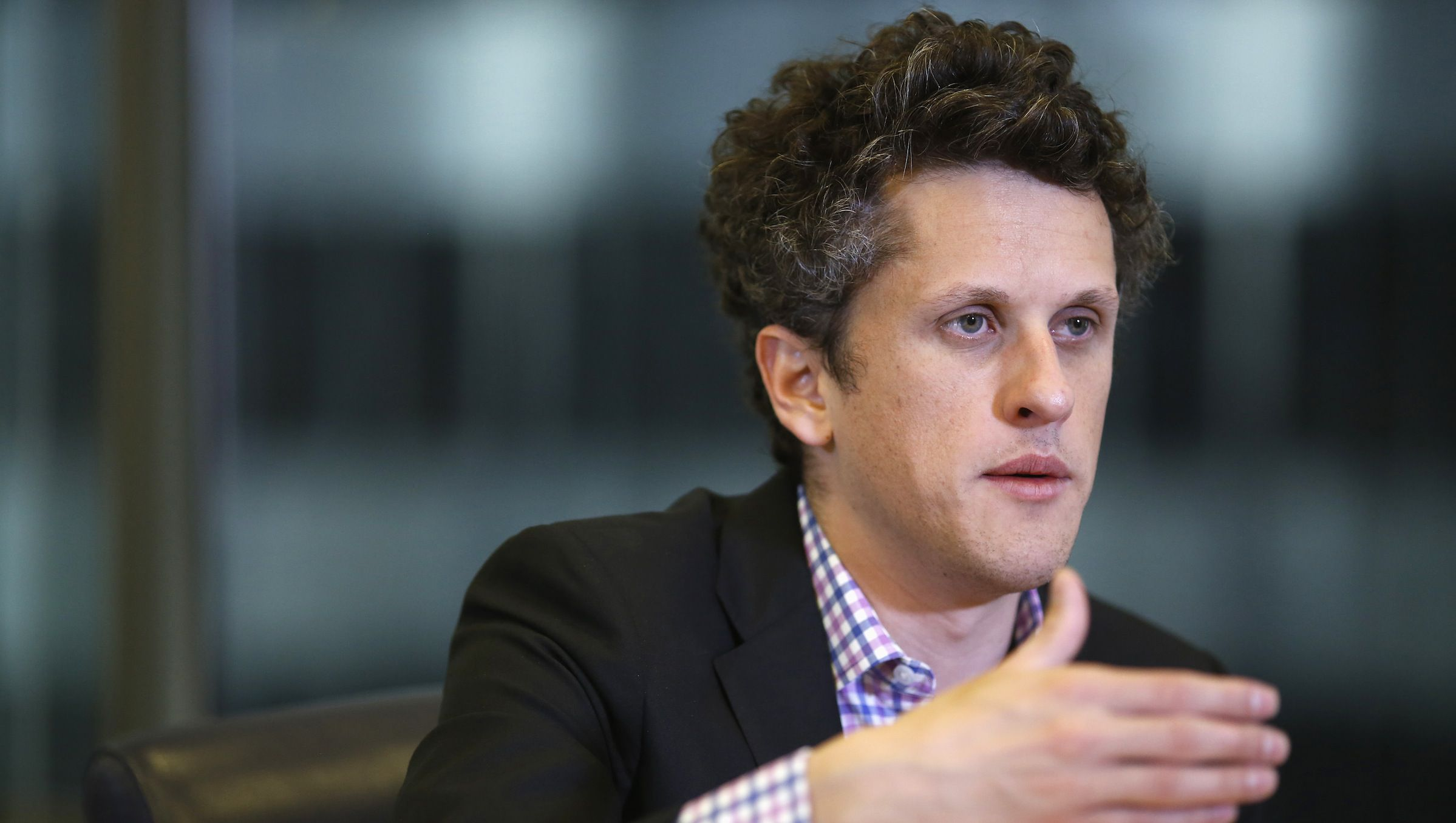 Aaron Levie, co-founder and chief executive of Box, speaks during Reuters Global Technology Summit in San Francisco, June 19, 2013. REUTERS/Stephen Lam (UNITED STATES - Tags: BUSINESS SCIENCE TECHNOLOGY) - RTX10U2I