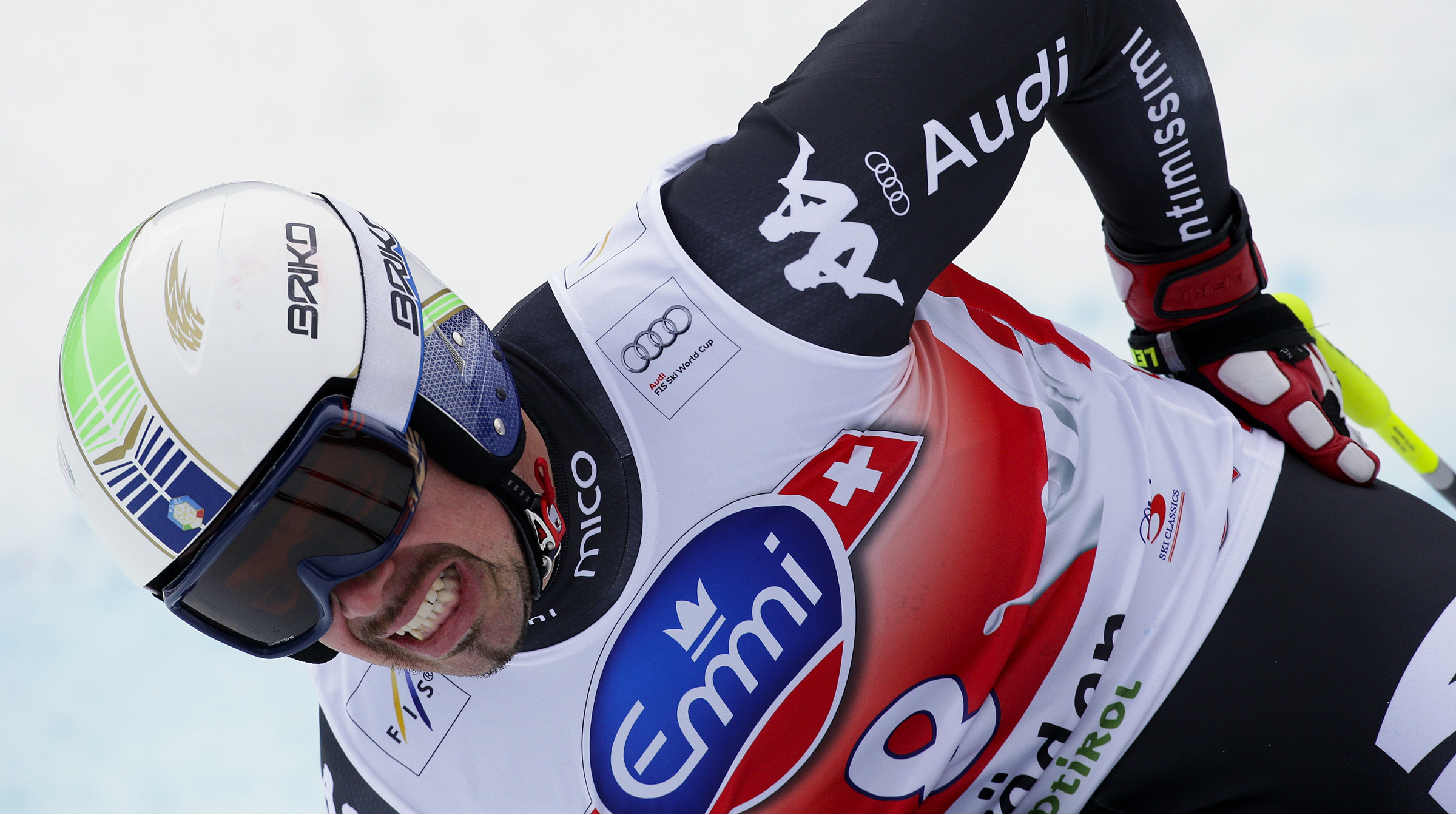 Peter Fill of Italy reacts in pain from a crash in the last gate, after crossing the finish line during the men's World Cup Super-G skiing race in Val Gardena December 20, 2013. REUTERS/Max Rossi (ITALY - Tags: SPORT SKIING) - RTX16PIN