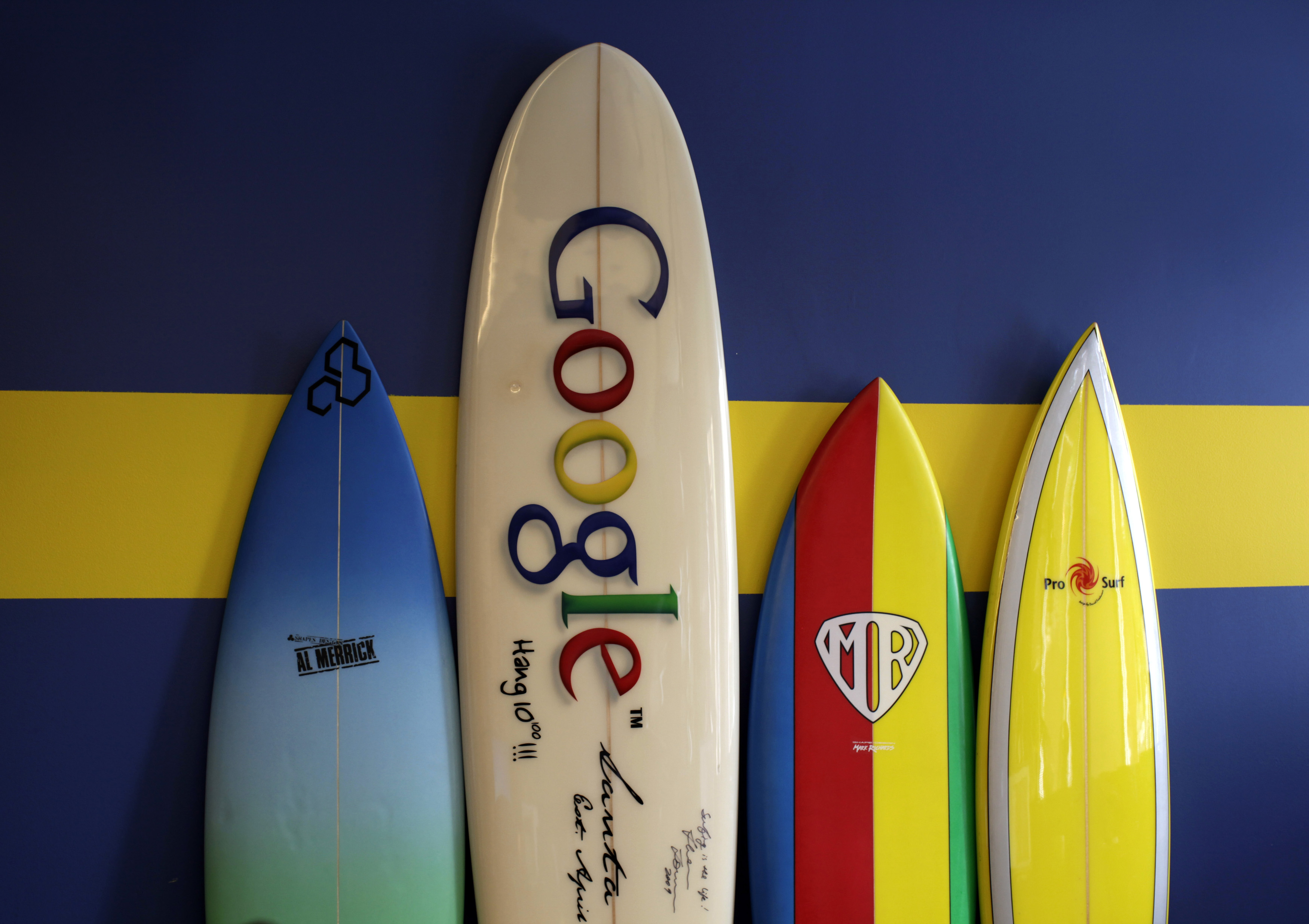 Surfboards lean against a wall at the Google office in Santa Monica, California, October 11, 2010. Google will report its third-quarter earnings on Thursday.  REUTERS/Lucy Nicholson (UNITED STATES - Tags: BUSINESS SCI TECH) - RTXTBOI