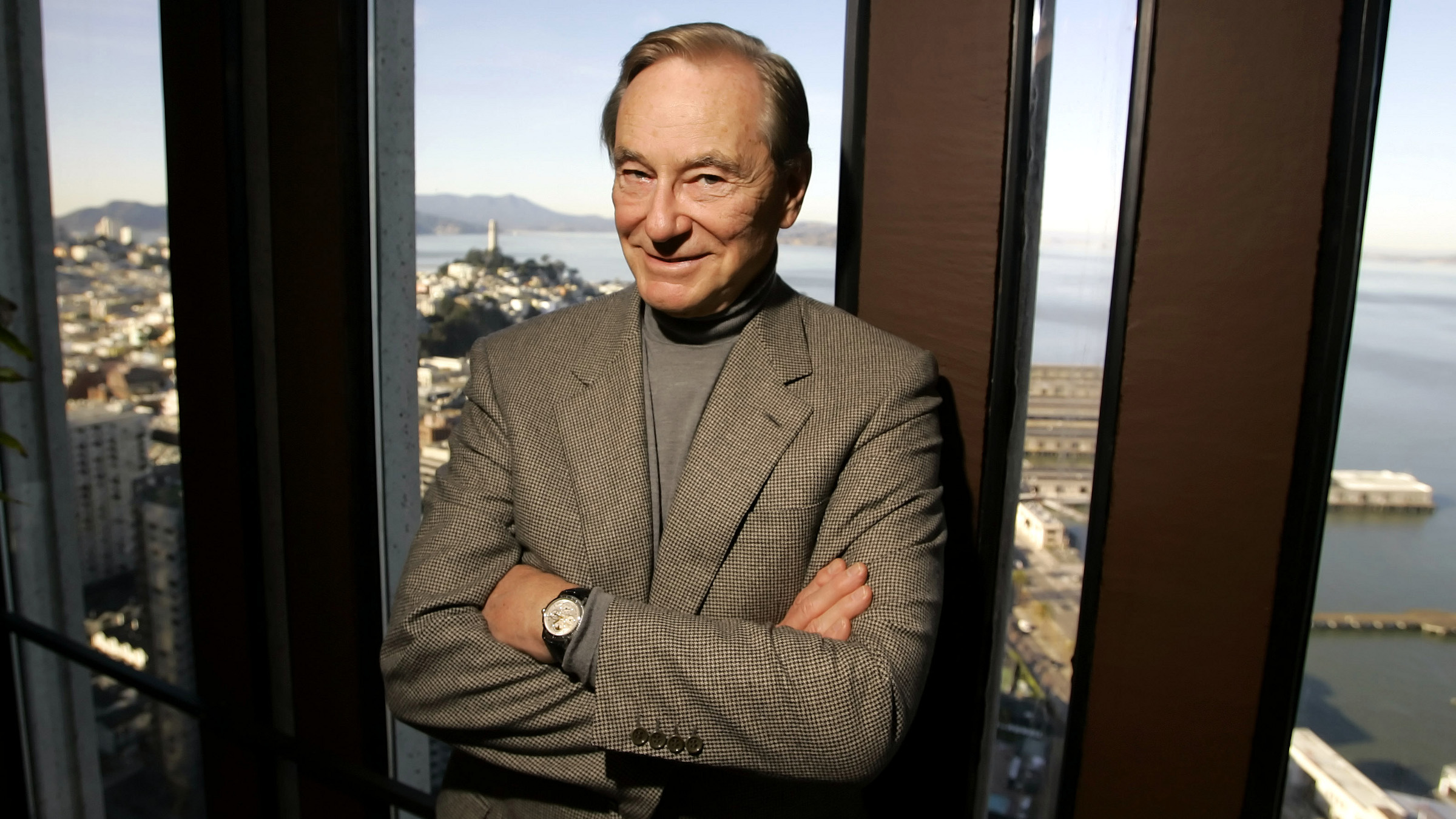 "Tom Perkins, 73, author of the novel, ""Sex and the Single Zillionaire,"" poses in his office in San Francisco, Monday Jan. 23, 2006. In the background is Telegraph Hill and San Francisco Bay. ()"